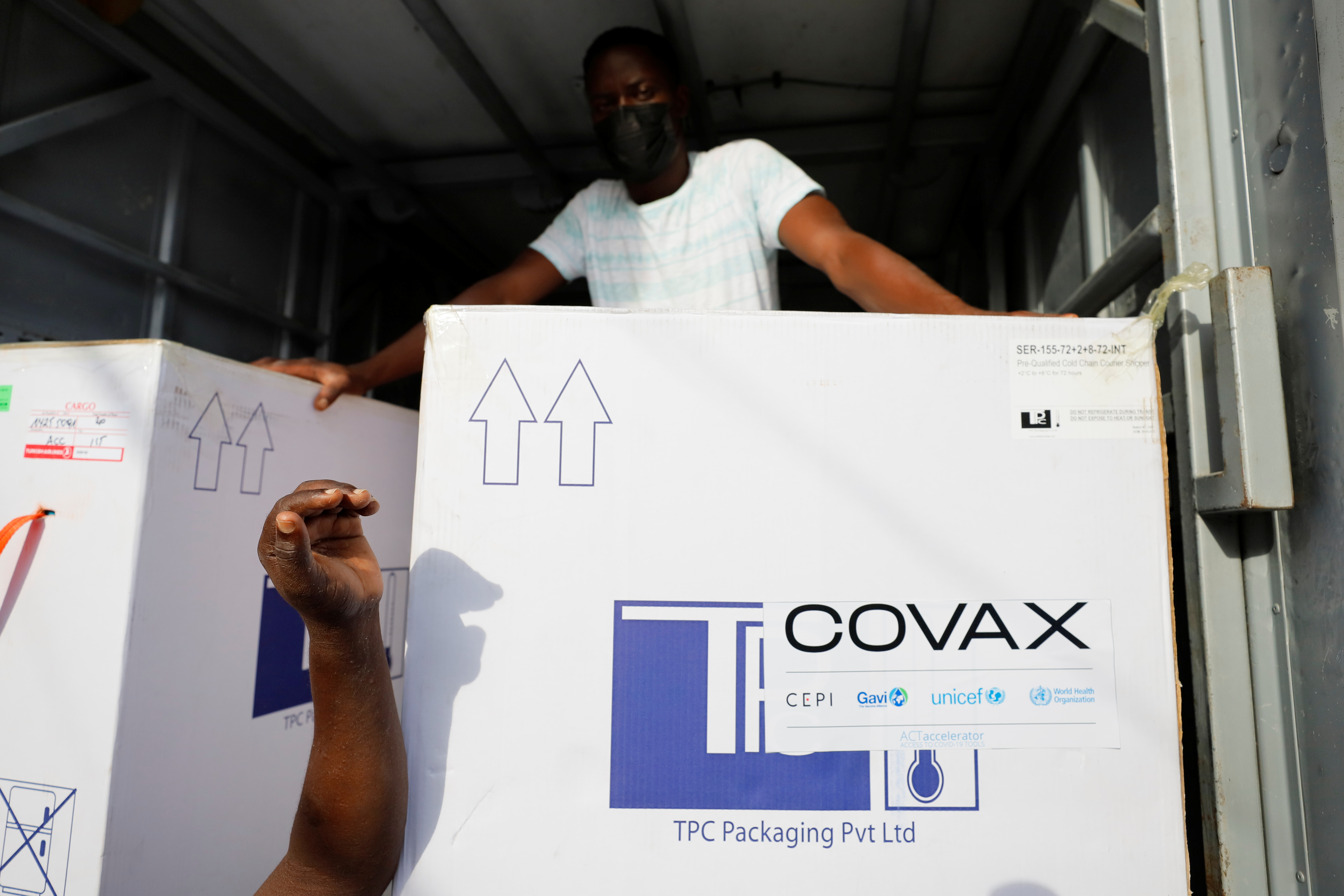 Boxes of Oxford/AstraZeneca coronavirus disease (COVID-19) vaccines, redeployed from the Democratic Republic of Congo, arrive at a cold storage facility in Accra, Ghana, May 7, 2021. REUTERS/Francis Kokoroko