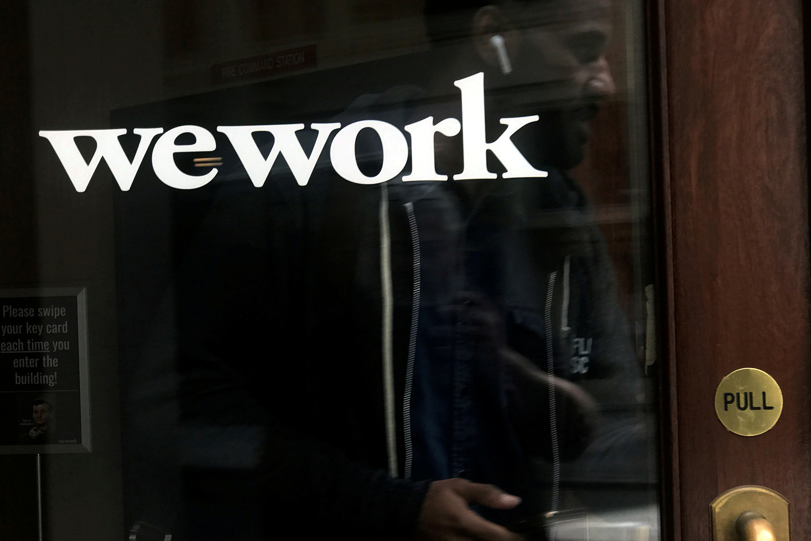 A man walks out of a WeWork space in the Manhattan borough of New York City, New York, U.S., October 4, 2019. REUTERS/Carlo Allegri/File Photo