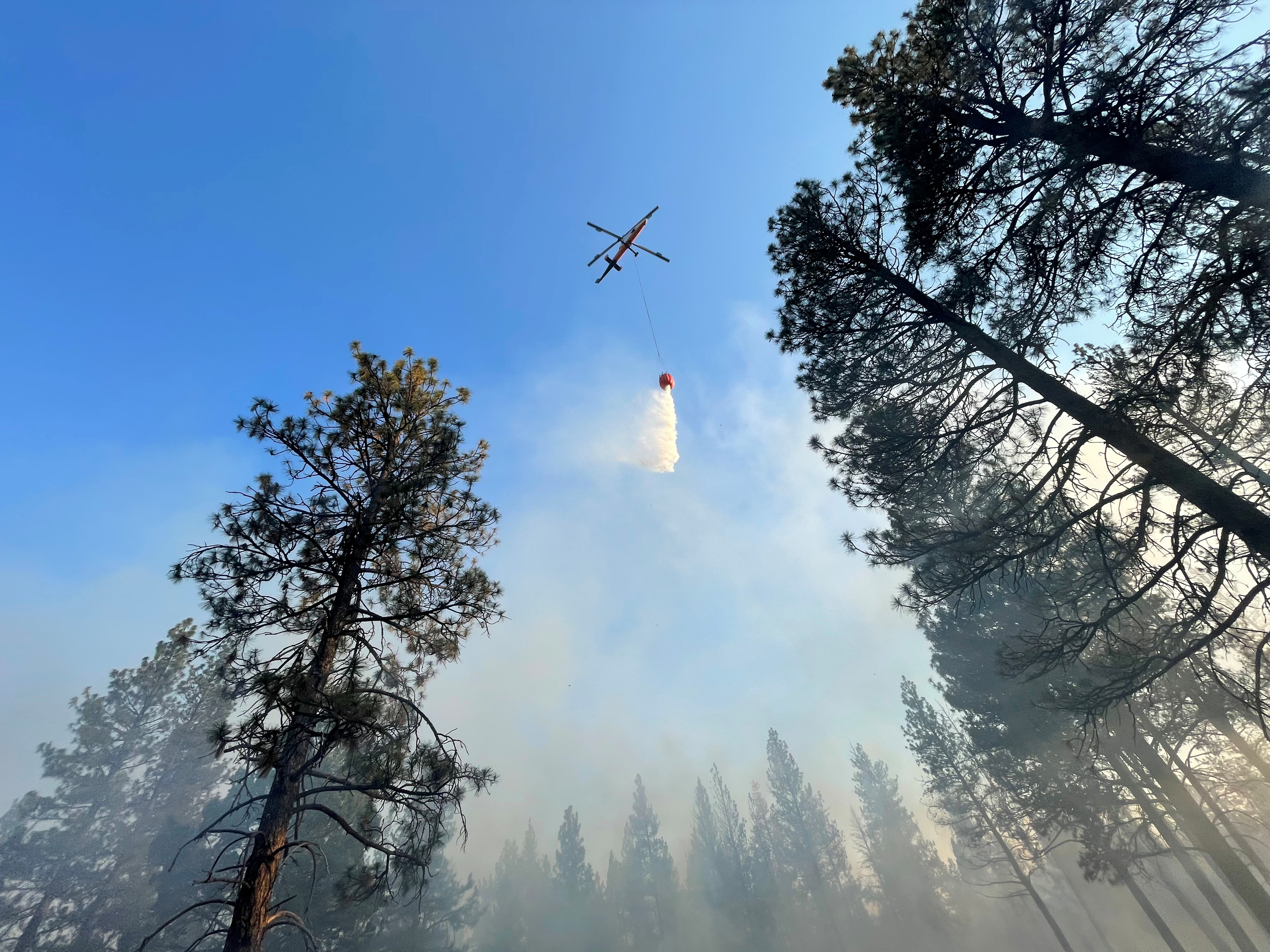 An aircraft flies over the Bootleg Fire as it rages in Klamath and Lake Counties, in Oregon, U.S., July 14, 2021. Picture taken July 14, 2021. OSFM Green Incident Management Team via REUTERS
