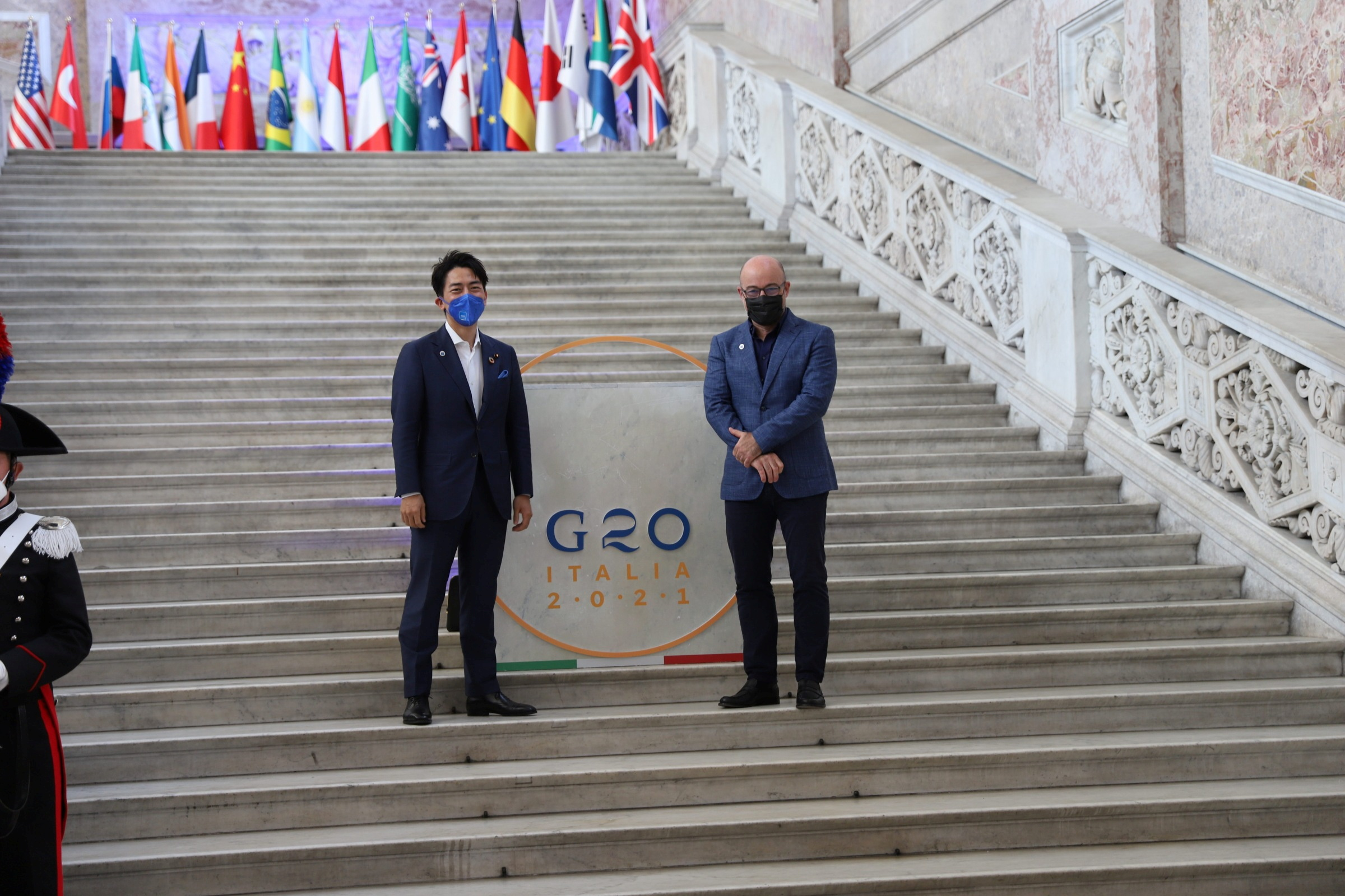 Japan's Environment Minister Shinjiro Koizumi and Italy's Ecological Transition Minister Roberto Cingolani pose for a photograph at the start of the G20 Environment, Climate and Energy Ministers' Meeting in Naples, Italy, July 22, 2021. G20Italy/Handout via REUTERS