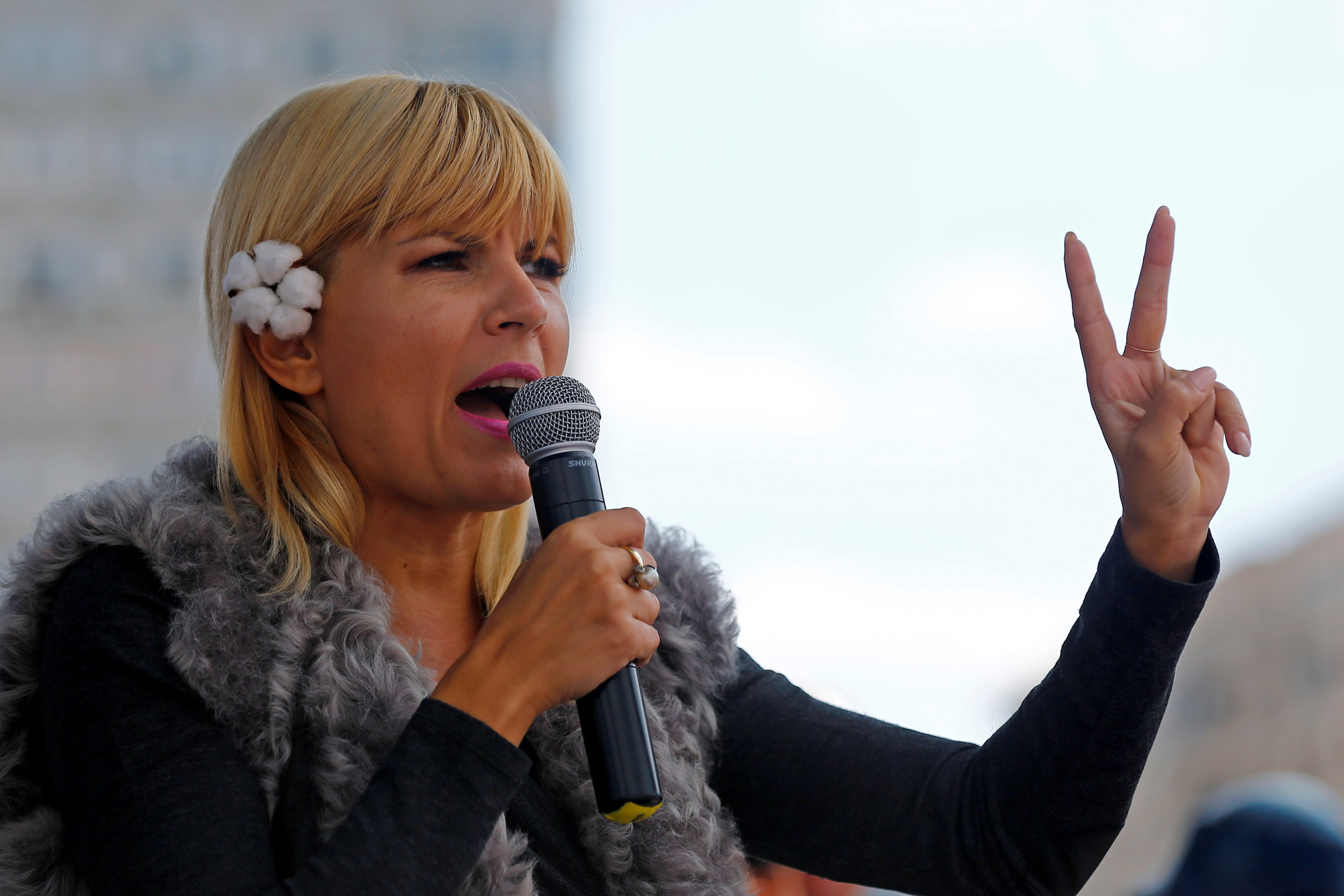 Elena Udrea, president of the People's Movement Party (PMP), addresses her supporters during a rally to launch her candidacy for Romania's upcoming presidential elections at Victoria square in Bucharest September 28, 2014. Romania will hold its presidential elections on November 2.  REUTERS/Bogdan Cristel/File Photo