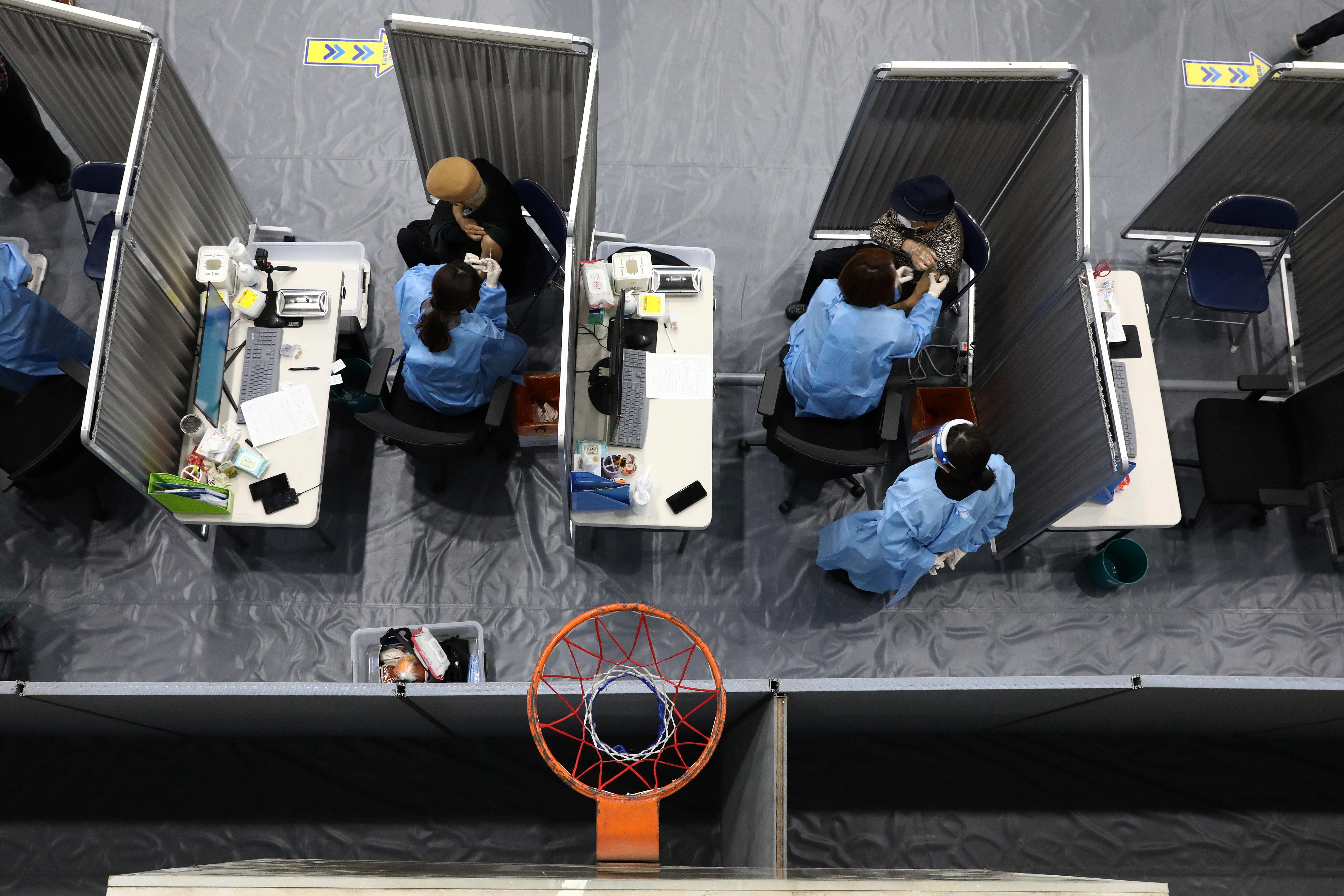 South Korean senior citizens receive their first dose of the Pfizer-BioNTech coronavirus disease (COVID-19) vaccine at a vaccination centre in Seoul, South Korea April 1, 2021. Chung Sung-Jun/Pool via REUTERS