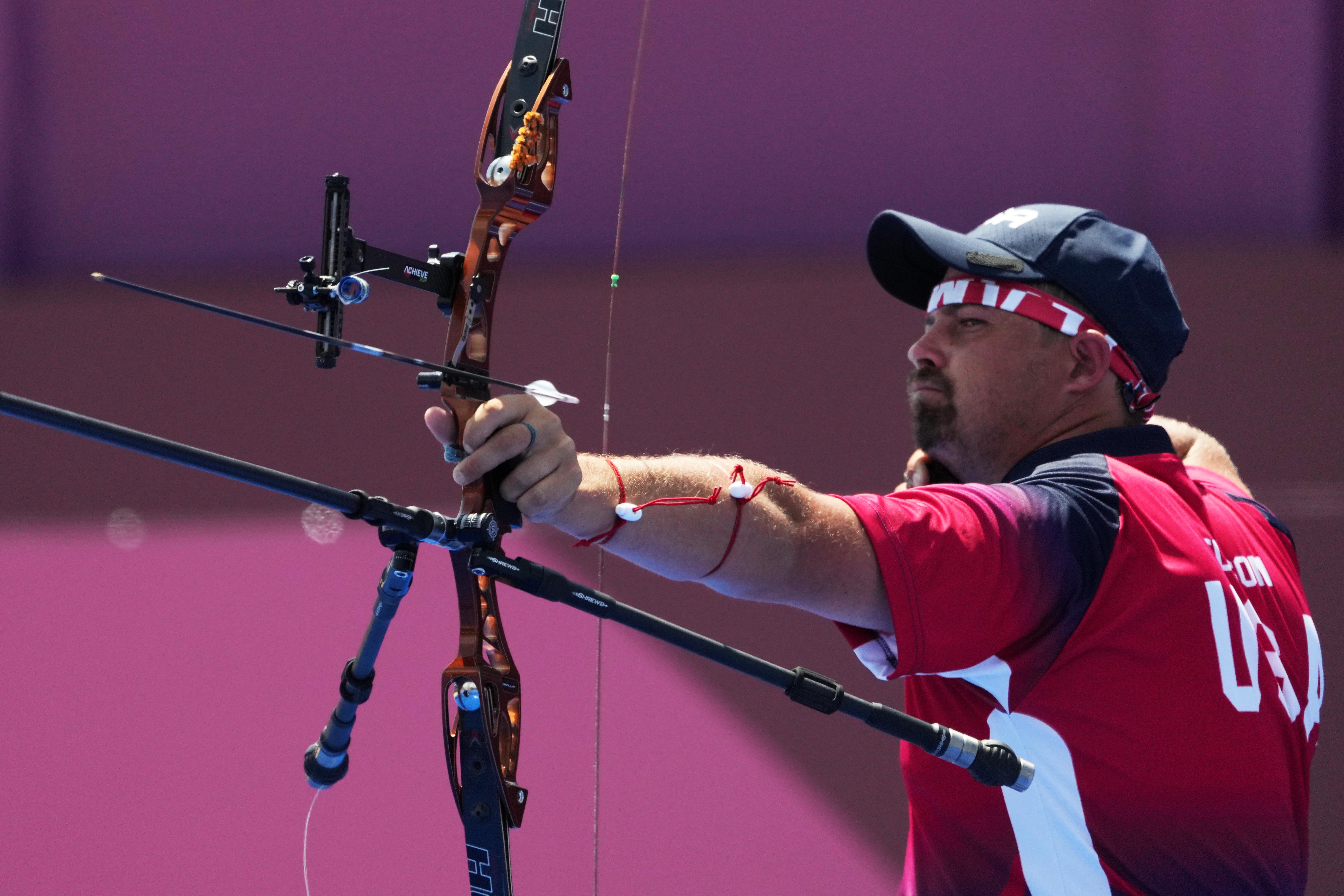 Jul 24, 2021; Tokyo, Japan; Brady Ellison (USA) competes in the mixed team elimination round during the Tokyo 2020 Olympic Summer Games at Yumenoshima Archery Field. Mandatory Credit: Kirby Lee-USA TODAY Network