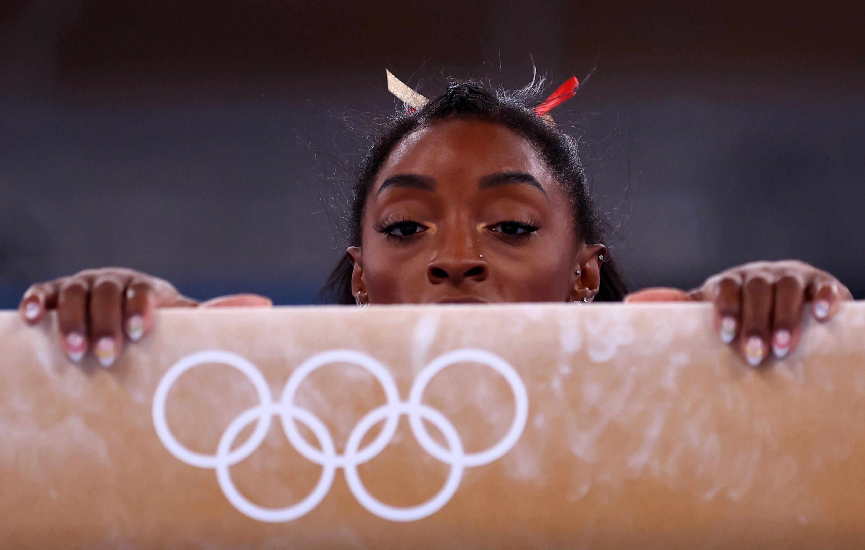 Tokyo 2020 Olympics - Gymnastics - Artistic - Women's Beam - Qualification - Ariake Gymnastics Centre, Tokyo, Japan - July 25, 2021. Simone Biles of the United States competes on the balance beam REUTERS/Mike Blake