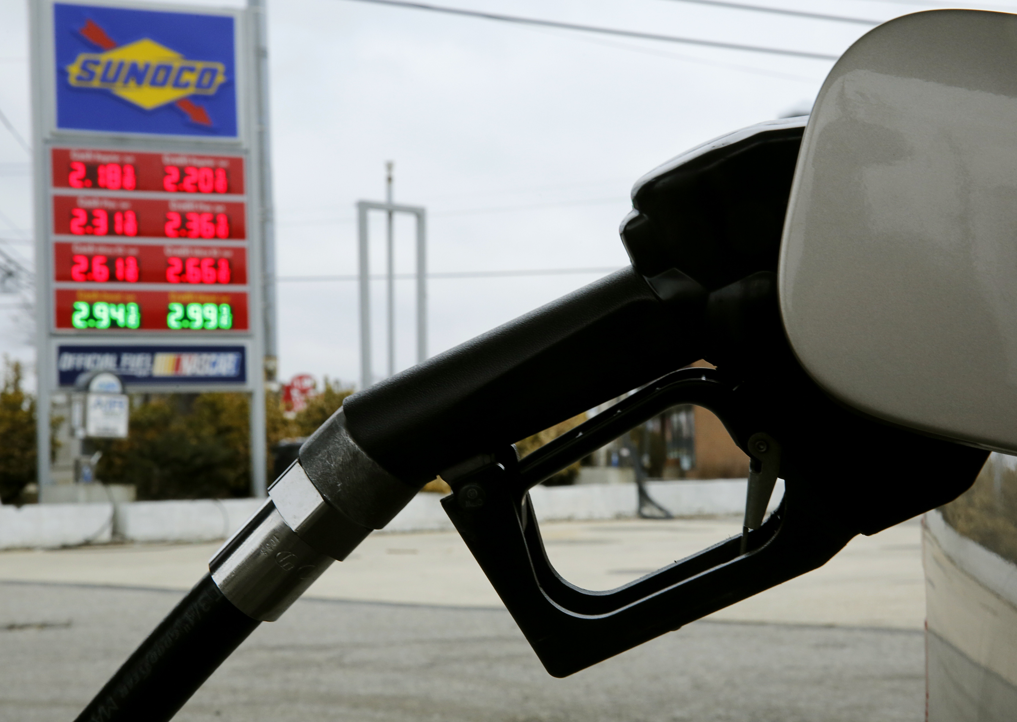 A Sunoco station with current gasoline and diesel prices is seen during a fill up in Colesville, Maryland, February 10, 2015. REUTERS/Gary Cameron