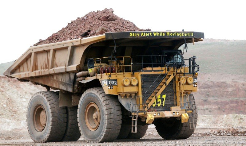 A haul truck carries a full load at a mine operation near Elko, Nevada May 21, 2014. REUTERS/Rick Wilking