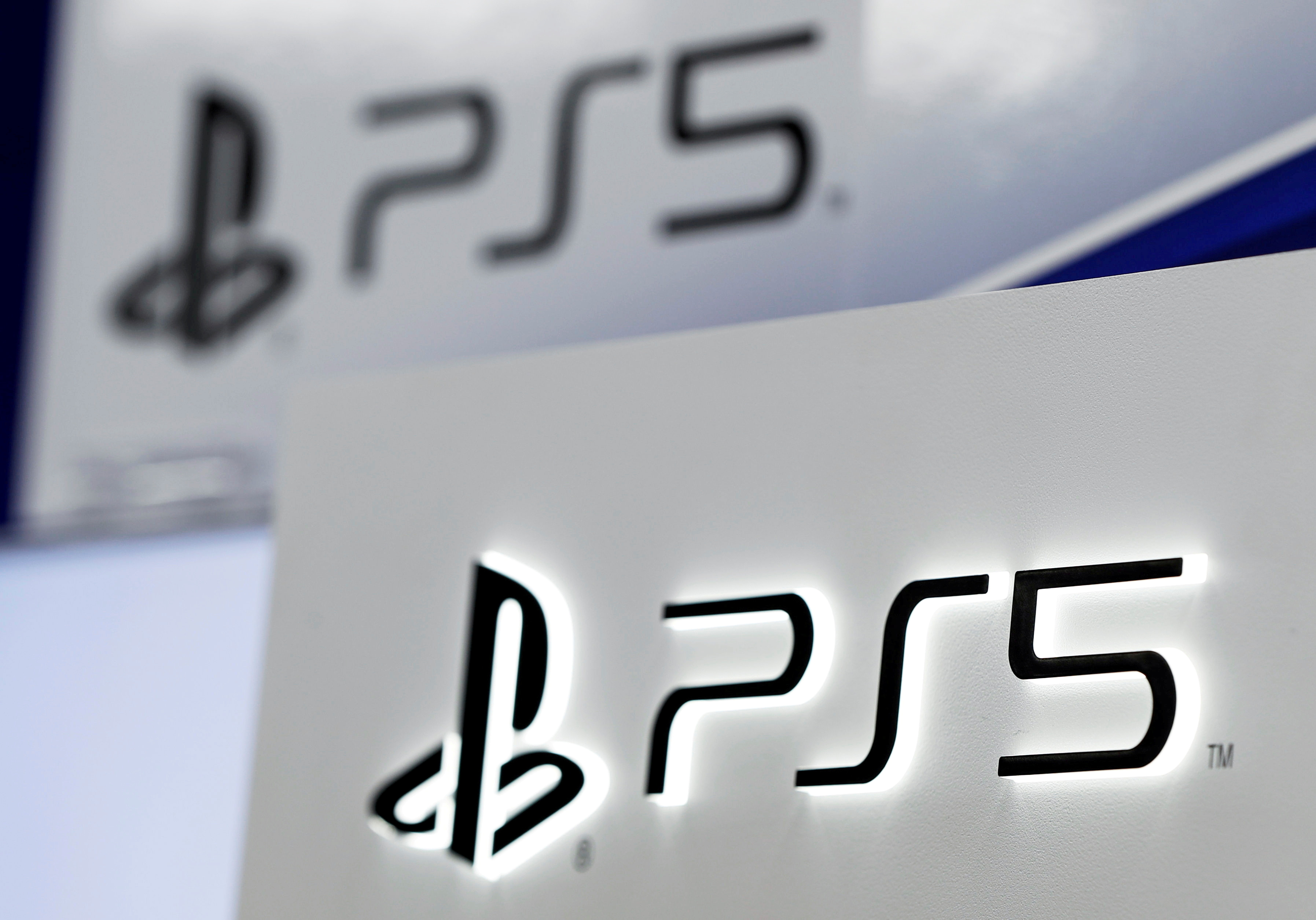 The logos of Sony's PlayStation 5 are displayed at the consumer electronics retailer chain Bic Camera, ahead of its official launch, in Tokyo, Japan November 10, 2020.  REUTERS/Issei Kato/File Photo