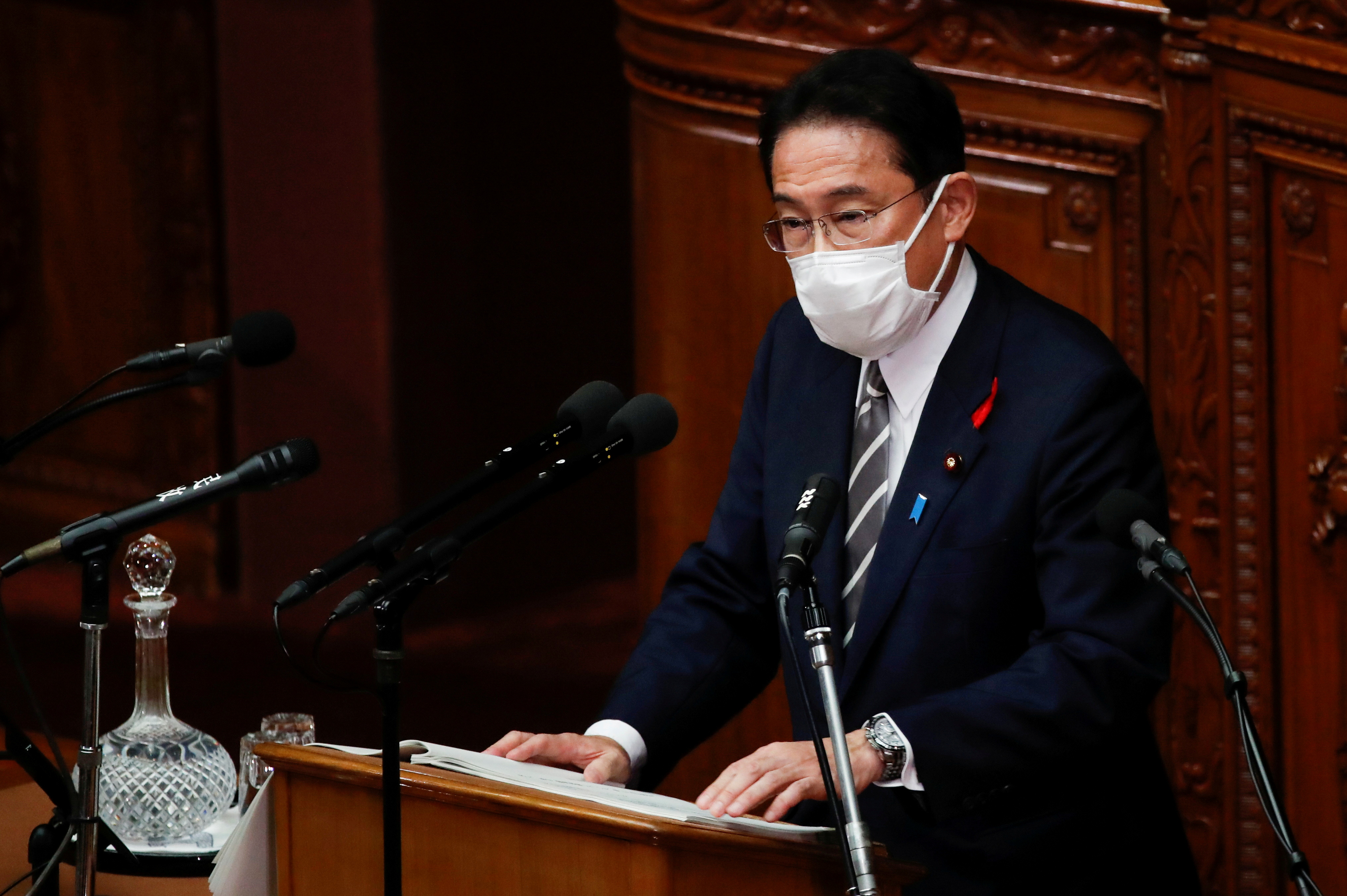 Japan's new prime minister Fumio Kishida delivers his first policy speech at parliament in Tokyo, Japan, October 8, 2021.   REUTERS/Kim Kyung-Hoon/File Photo