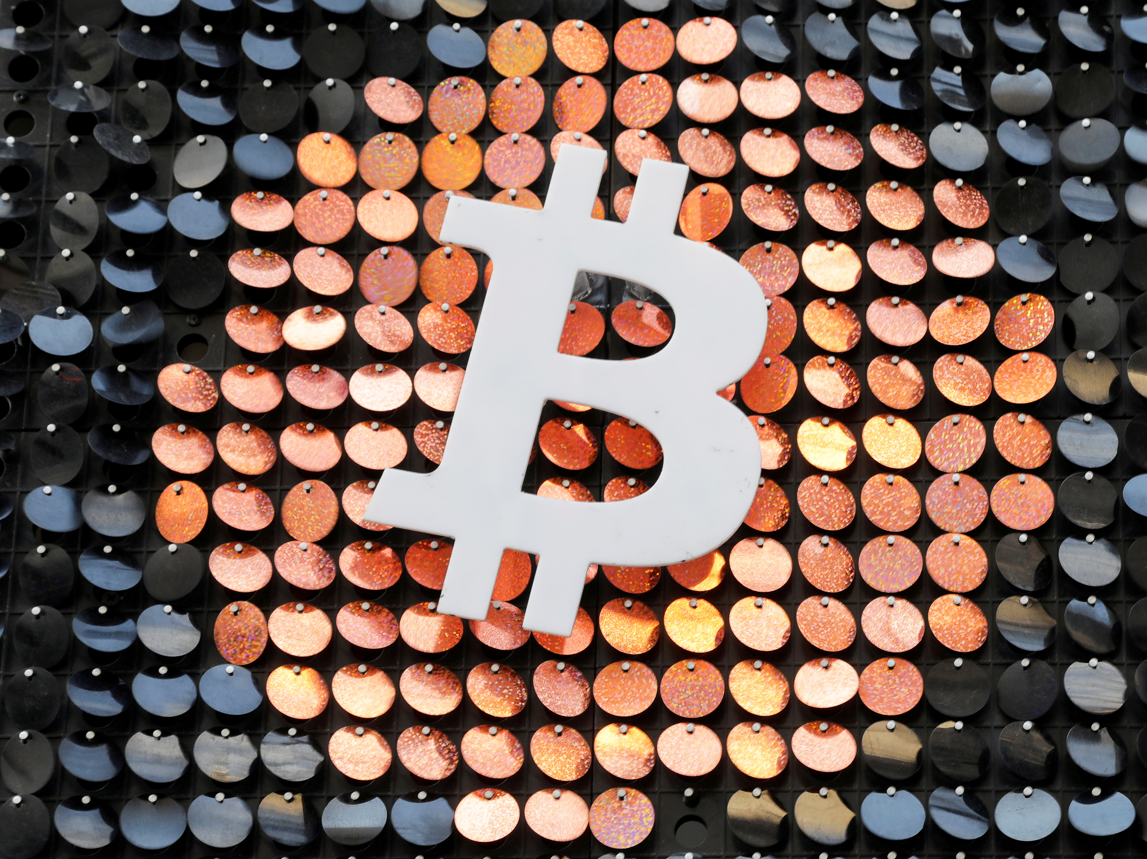 File photo: The logo of the Bitcoin digital currency is seen in a shop in Marseille, France, February 7, 2021. REUTERS/Eric Gaillard