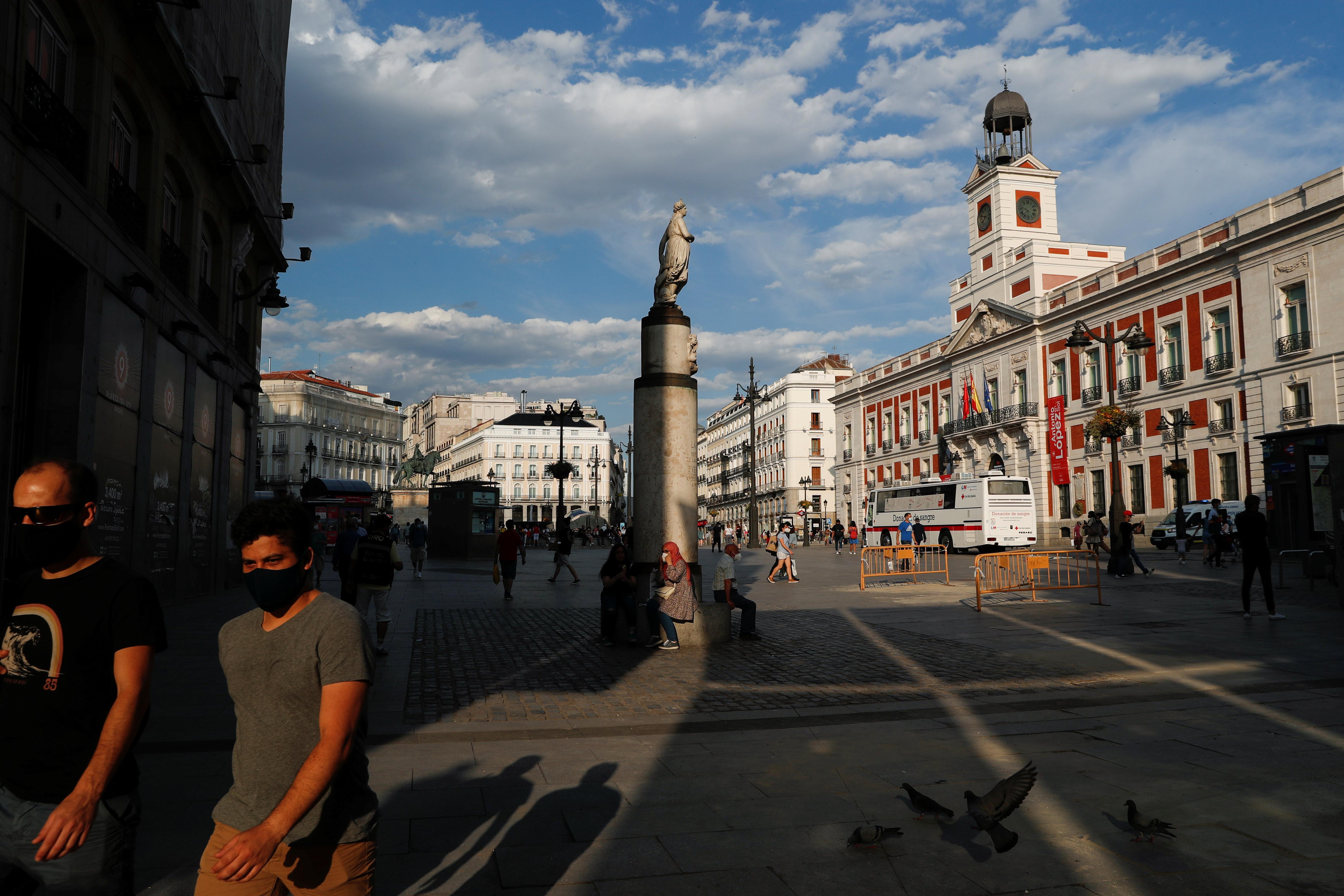 People hang out at Madrid's landmark Puerta del Sol square, Spain, June 7, 2021. REUTERS/Susana Vera