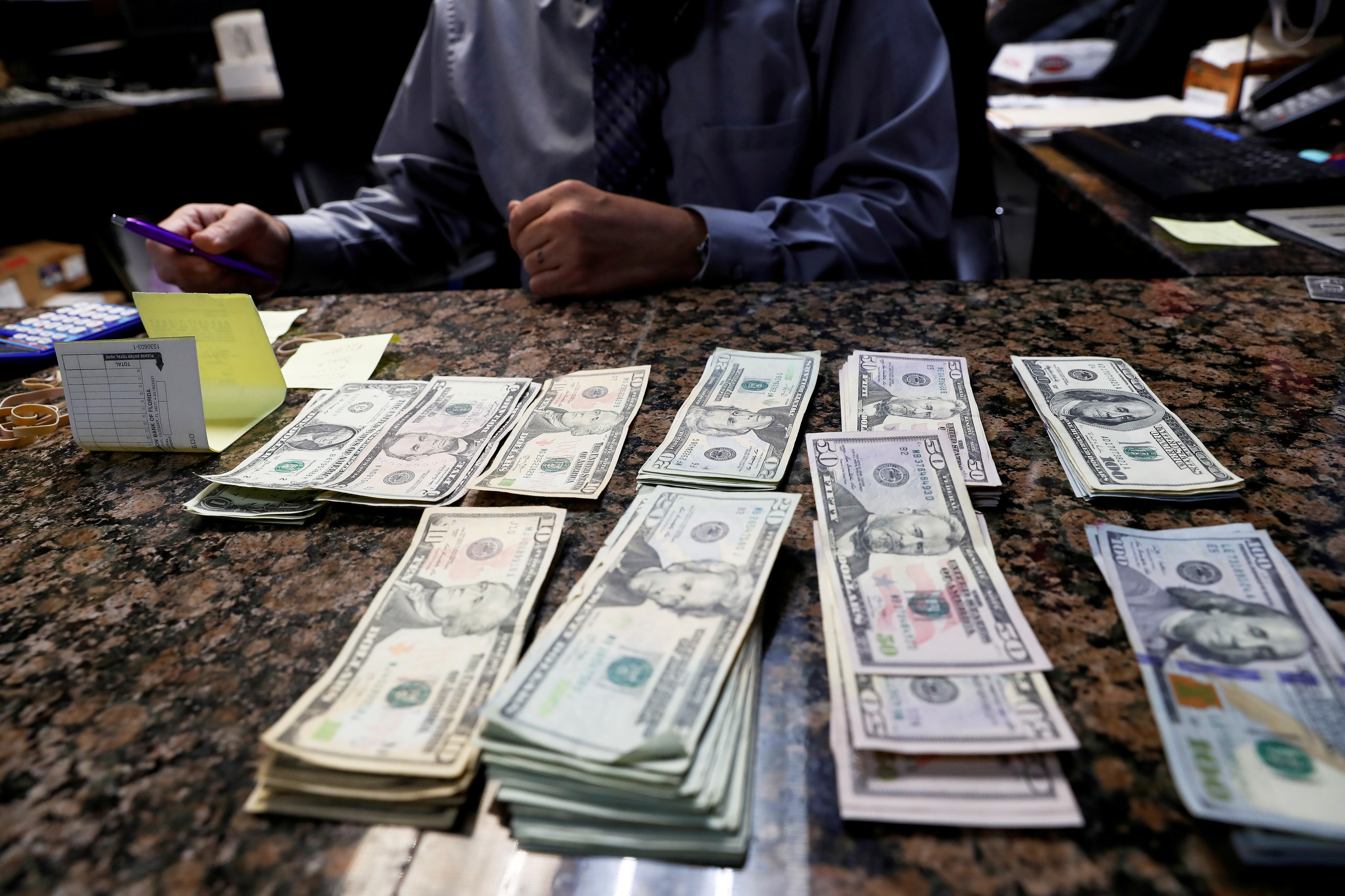 Carlos Gonzalez, managing partner of the Oz Ladies' and Gentlemen's Nightclub, counts money ahead of the Tampa Bay area weekend NFL' Super Bowl LV amid the ongoing spread of the coronavirus disease (COVID-19) at in Clearwater, Florida, February 5, 2021.  REUTERS/Shannon Stapleton/File Photo