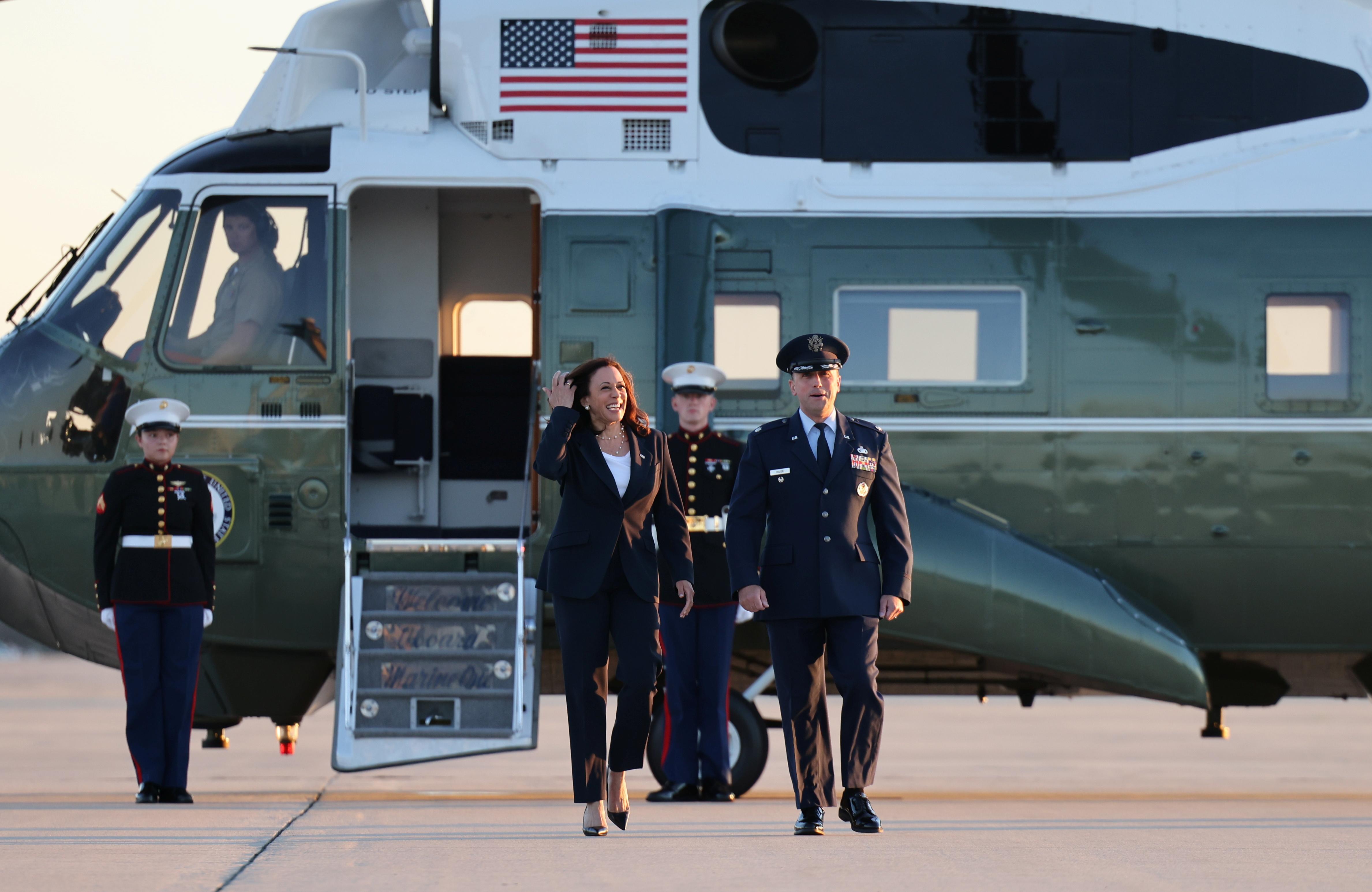 U.S. Vice President Kamala Harris walks with Lt. Col Richard