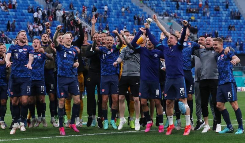 Soccer Football - Euro 2020 - Group E - Poland v Slovakia - Saint Petersburg Stadium, Saint Petersburg, Russia- June 14, 2021 Slovakia players celebrate after the match Pool via REUTERS/Evgenia Novozhenina