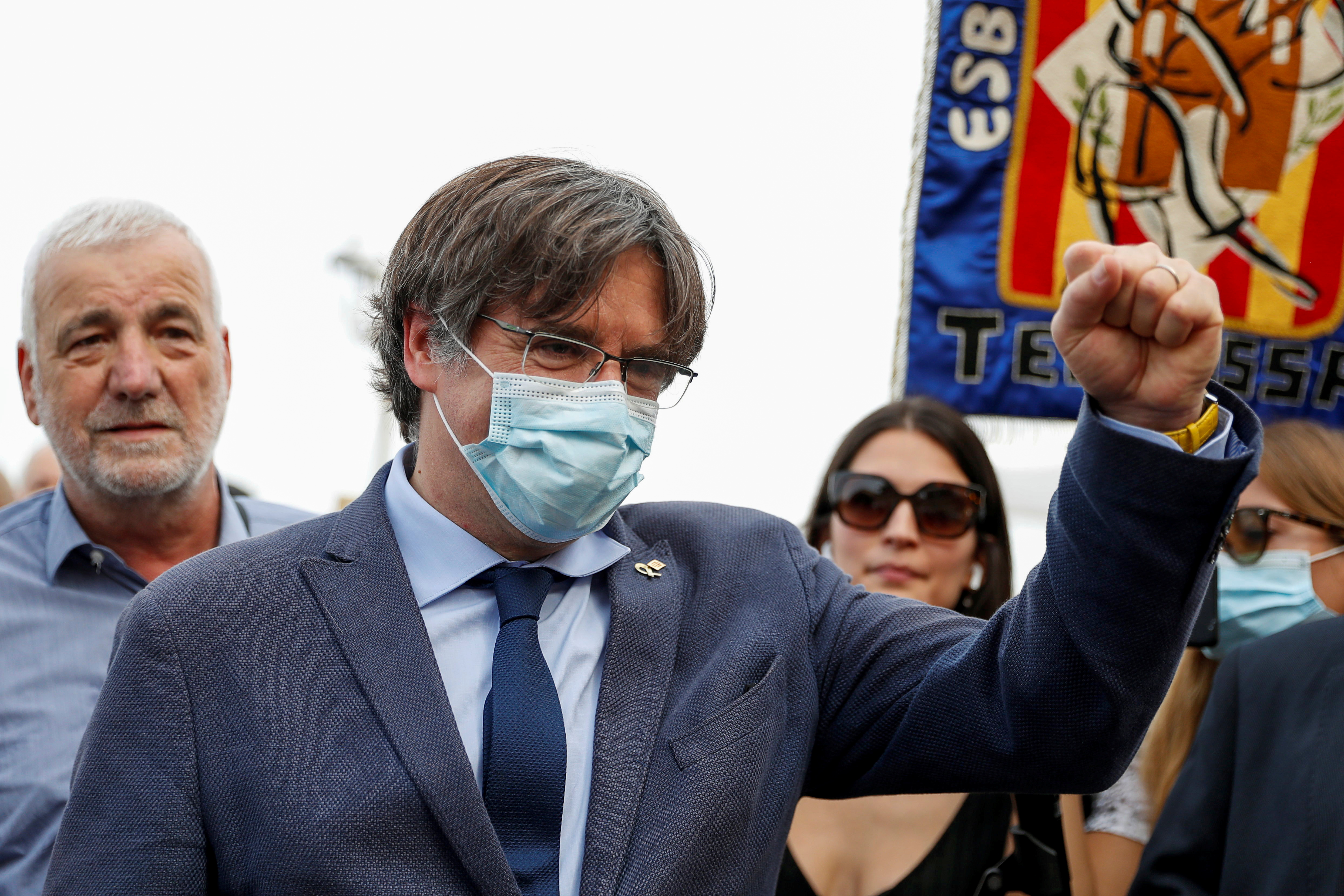 Former Catalan government head Carles Puigdemont gestures as he walks in Alghero, Italy, September 25, 2021. REUTERS/Yara Nardi