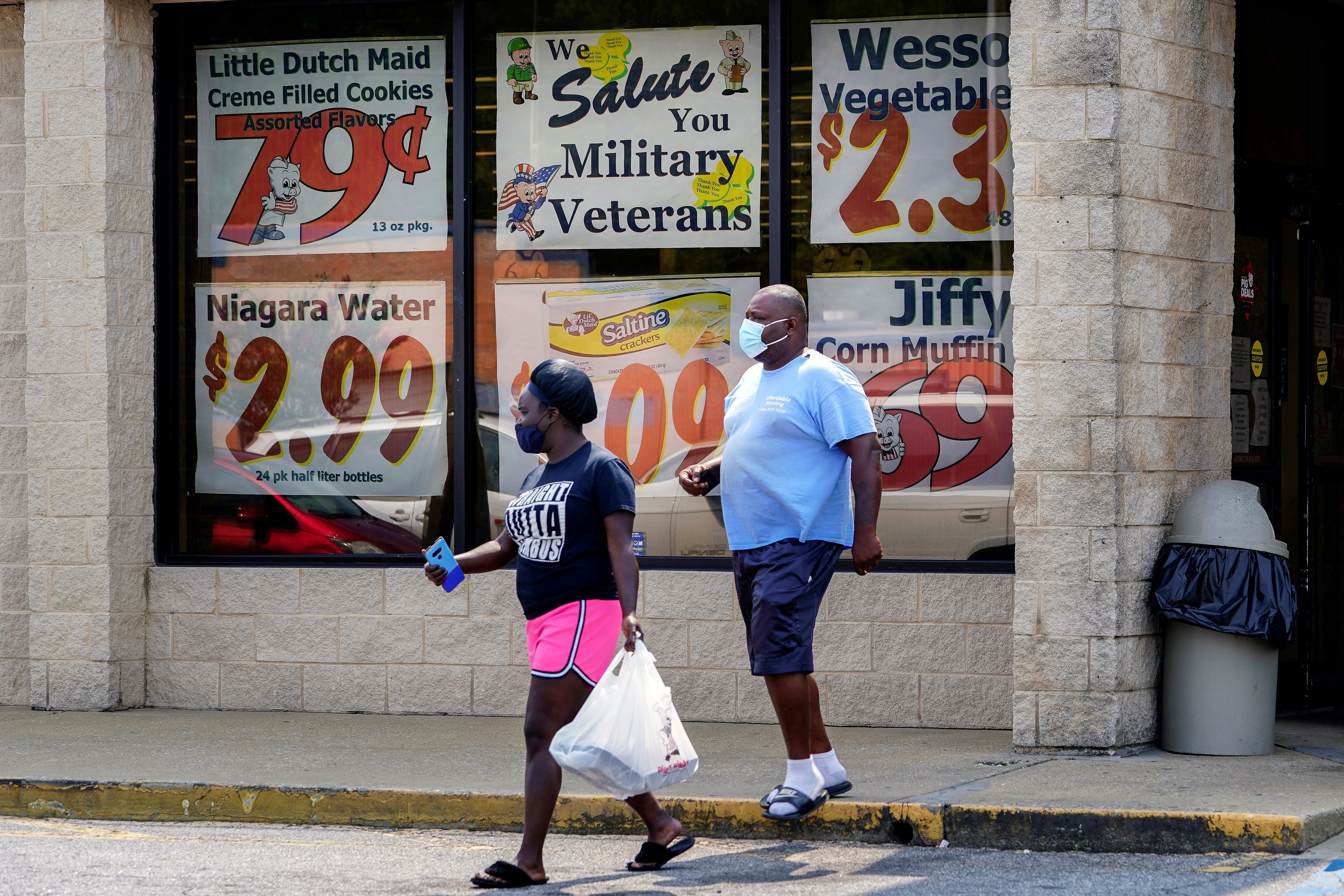 Shoppers leave a Piggly Wiggly supermarket with a sign honoring veterans in its window in Columbus, Georgia, U.S. September 8, 2020. REUTERS/Elijah Nouvelage/File Photo