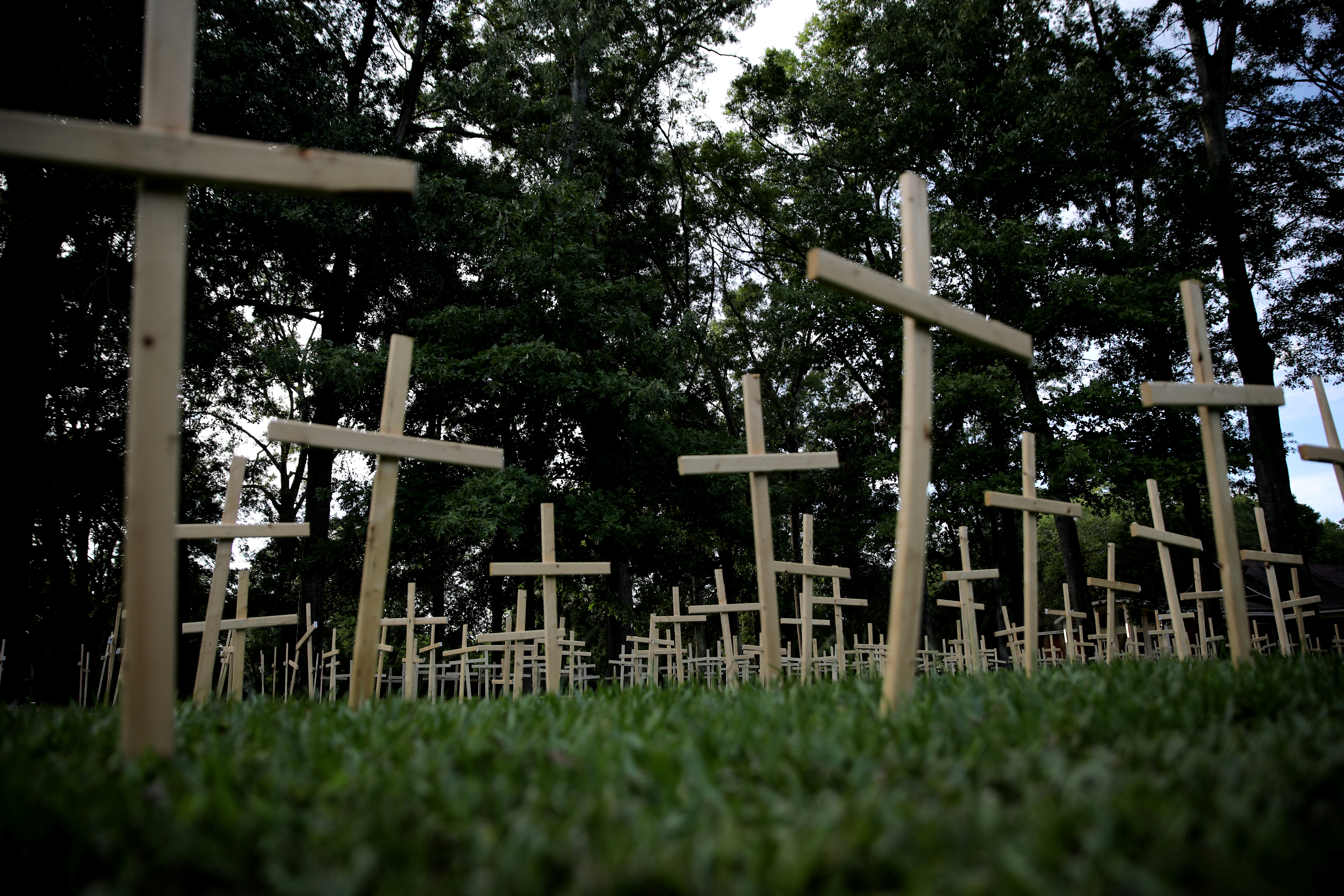 Crosses are seen outside of a church, as each cross represents one life lost to coronavirus disease (COVID-19) in the state of Louisiana, in Baton Rouge, Louisiana U.S., April 10, 2020. REUTERS/Carlos Barria