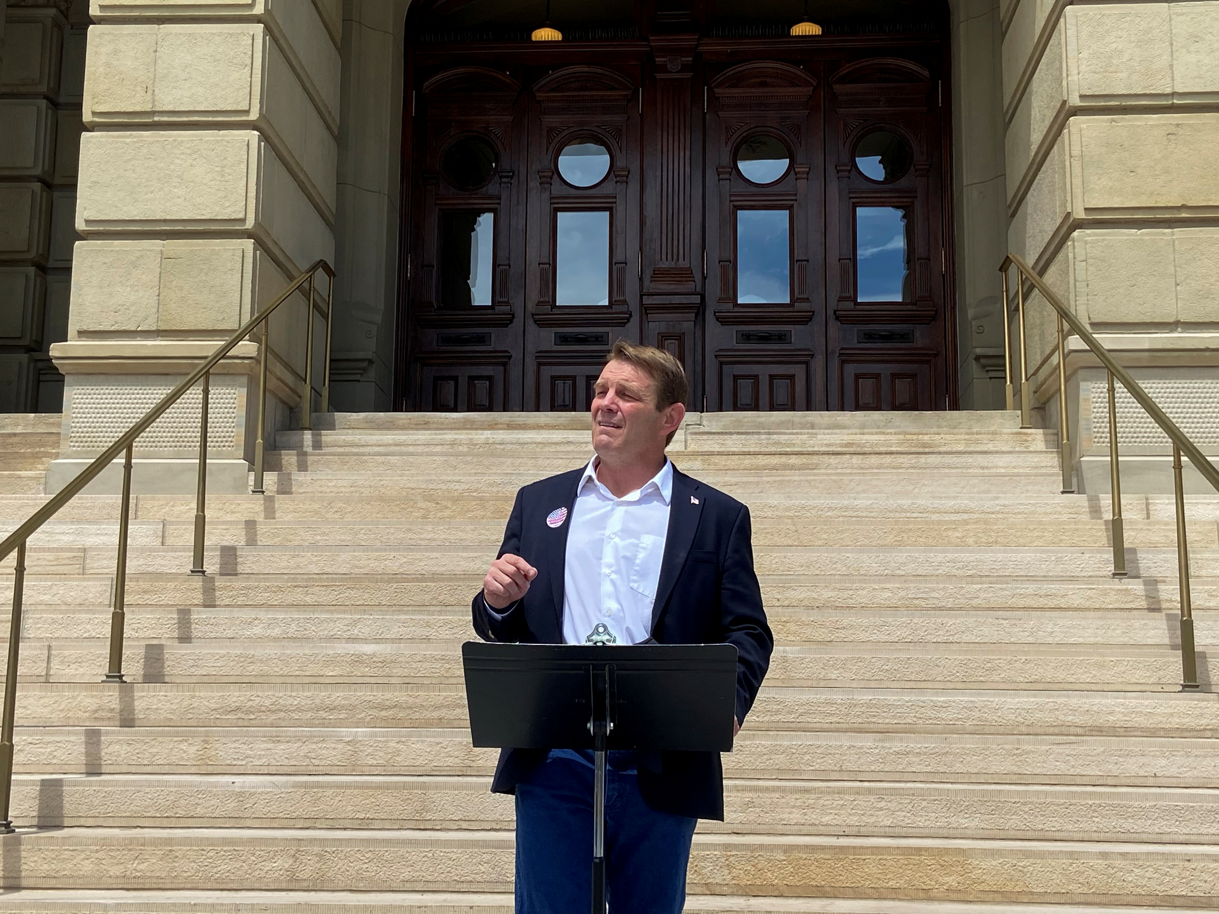 Republican attorney and businessman Darin Smith announces his primary campaign against incumbent Congresswoman Liz Cheney in front of the state Capitol in Cheyenne, Wyoming, U.S., May  7, 2021. Picture taken May  7, 2021. REUTERS/Nathan Layne