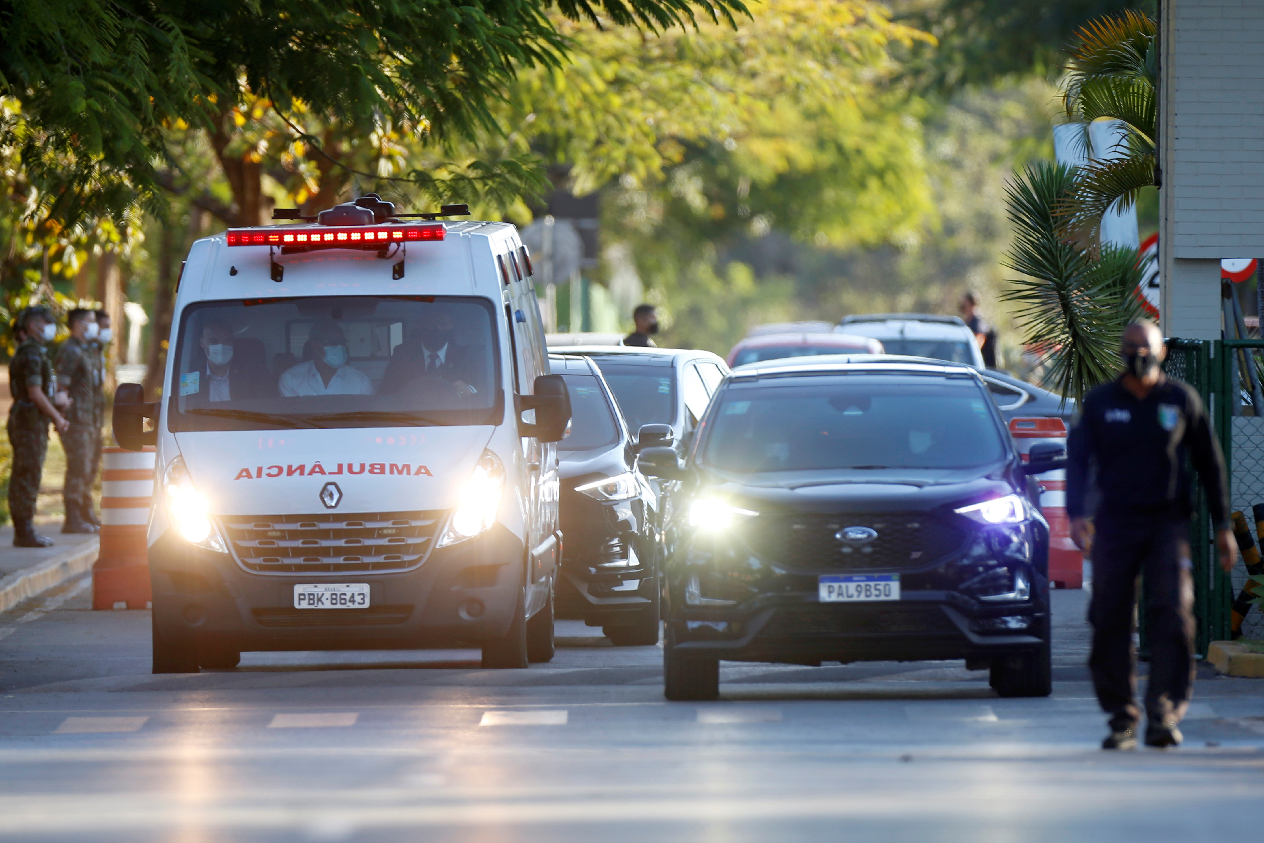 A presidential convoy with an ambulance transporting Brazil's President Jair Bolsonaro leaves the armed forces hospital (HFA) in Brasilia, Brazil July 14, 2021. REUTERS/Adriano Machado