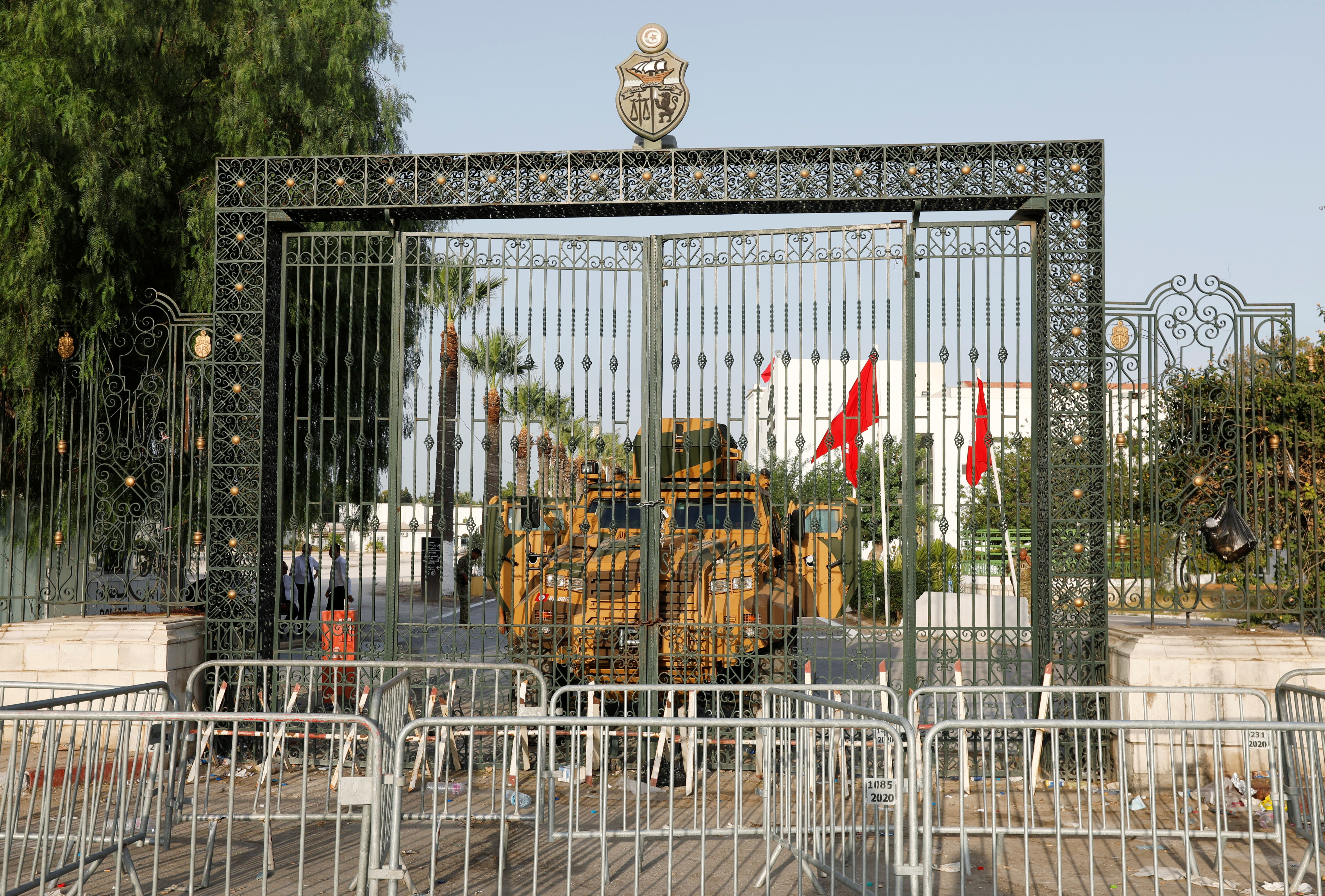 A military vehicle is pictured in front of the parliament building in Tunis, Tunisia  July 26, 2021. REUTERS/Zoubeir Souissi
