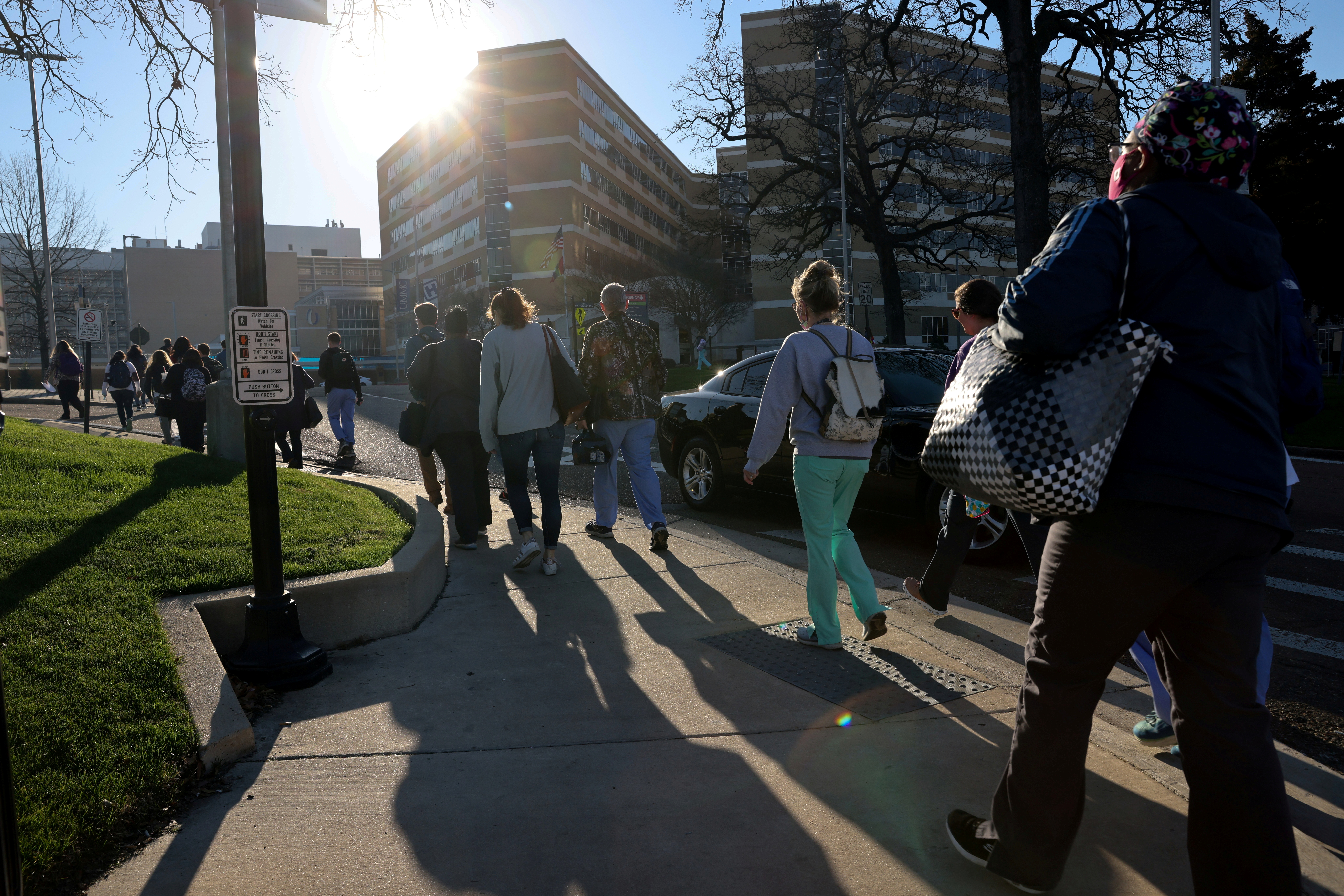 Health care workers arrive for the morning shift at the University of Mississippi Medical Center, in the state capital of one of the first U.S. states to declare themselves fully open after a year of lockdowns, and closures during the coronavirus disease (COVID-19) outbreak in Jackson, Mississippi, U.S. March 9, 2021.  REUTERS/Jonathan Ernst