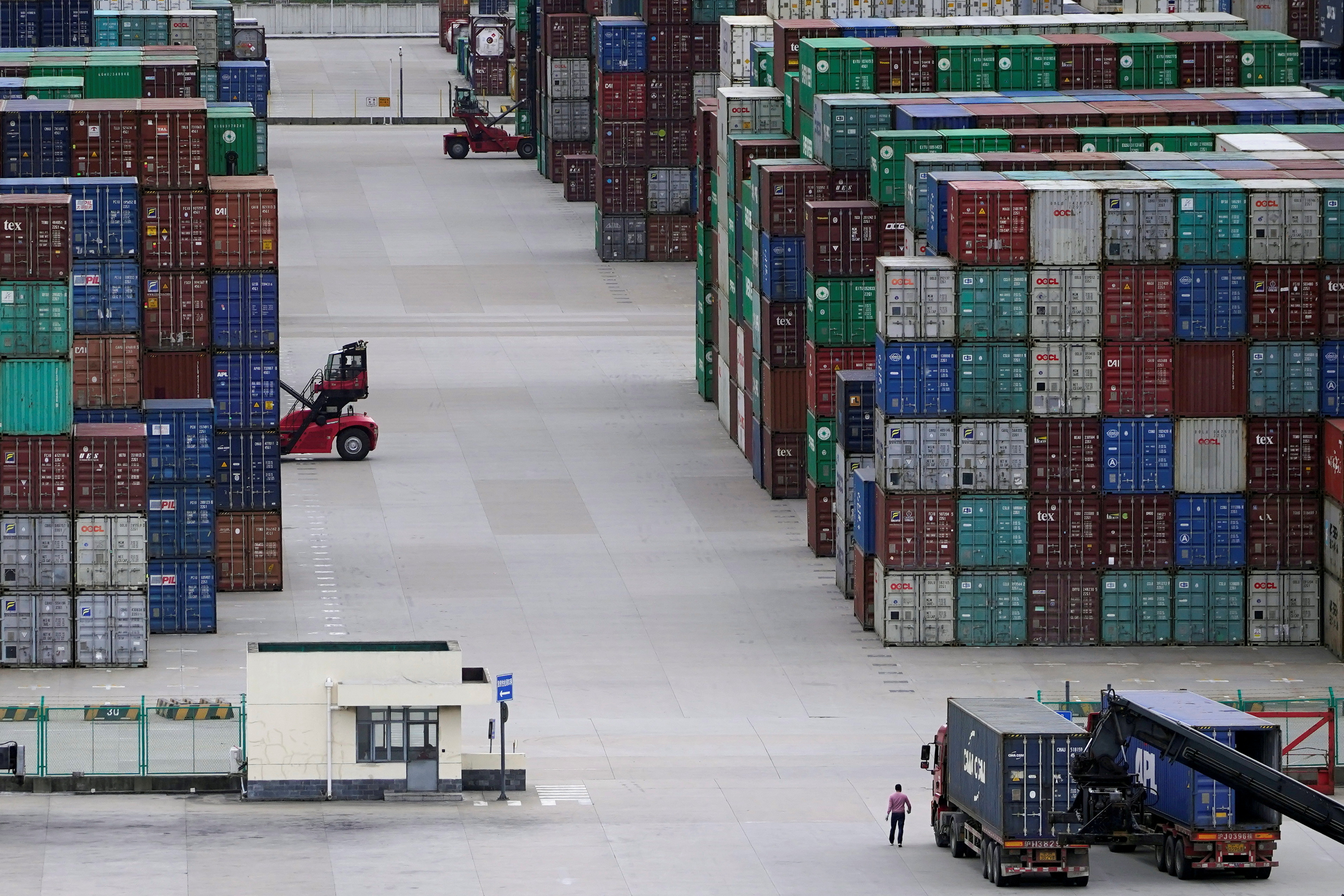 Containers are seen at the Yangshan Deep-Water Port in Shanghai, China October 19, 2020. REUTERS/Aly Song/File Photo
