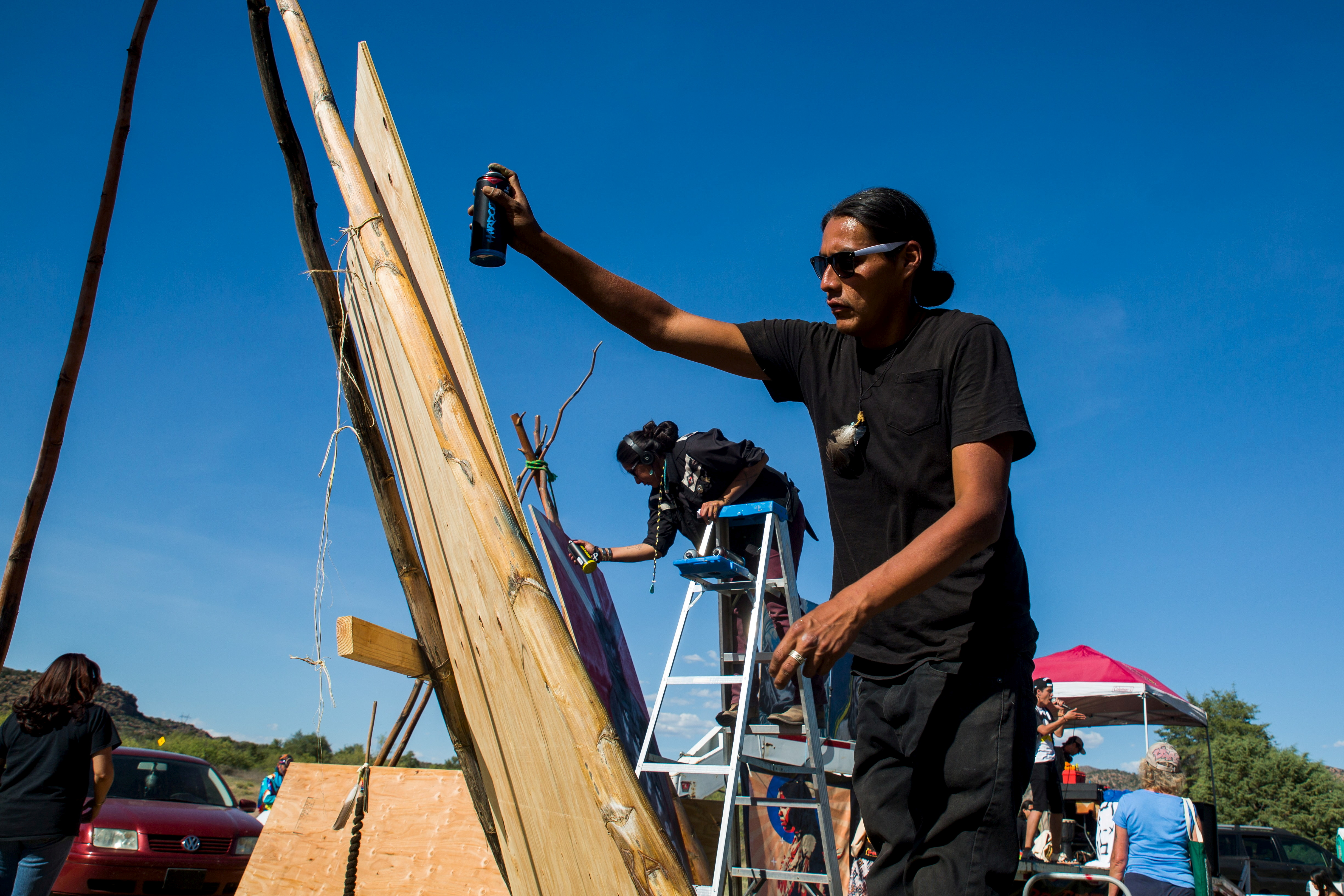 Jake Toledo, 28, of the Navajo nation paints during a rally at the Oak Flat Campground in the Tonto National Forest near Superior, Arizona May 30, 2015. Considered a home to the San Carlos Apache tribe, the site is slated for development into a copper mine by Rio Tinto. REUTERS/Deanna Dent/File Photo