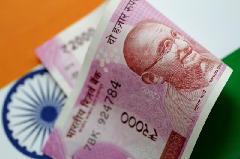 An India Rupee note is seen in this illustration photo June 1, 2017. REUTERS/Thomas White/Illustration/File photo