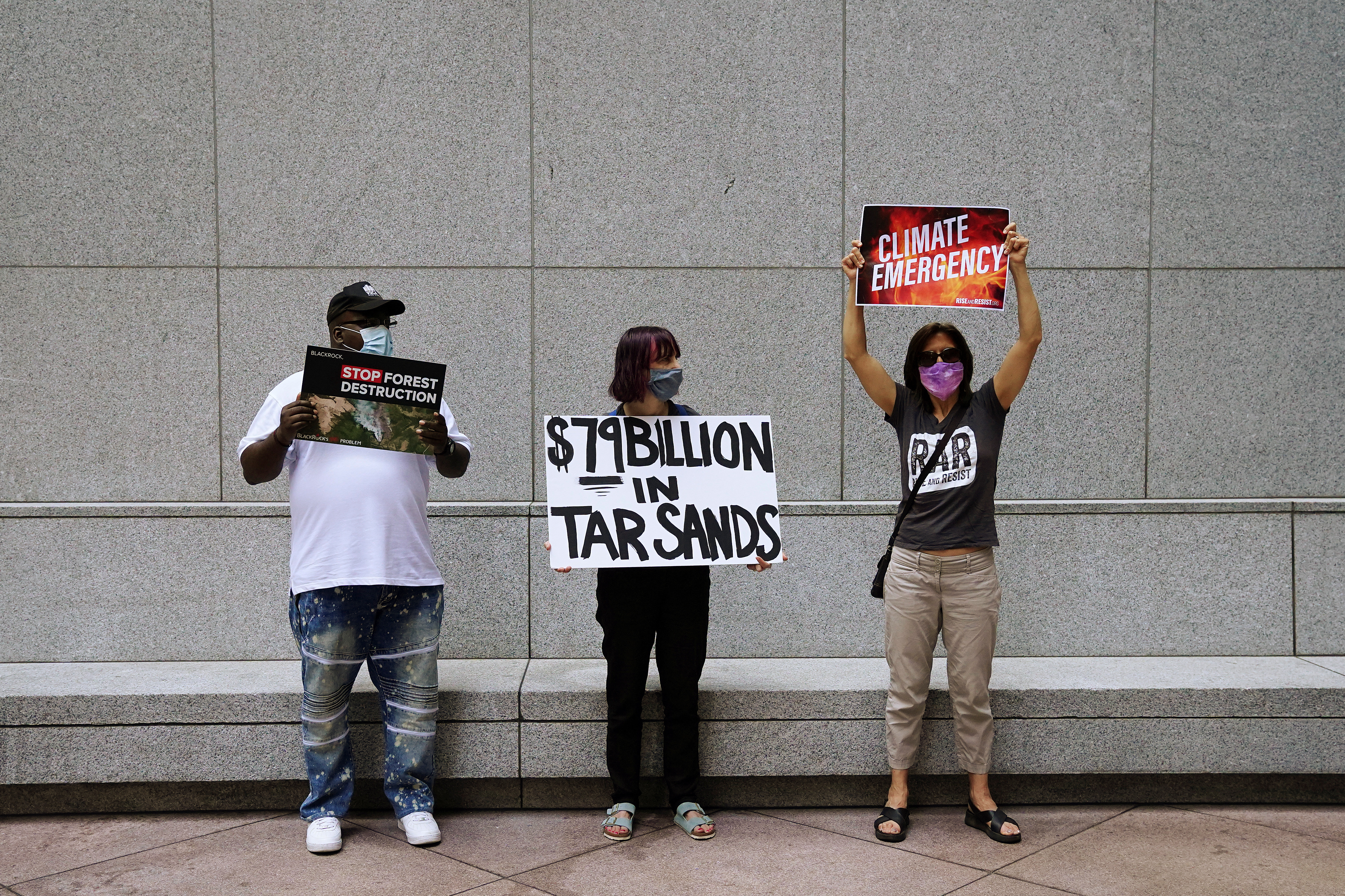 People protest against BlackRock investing in coal and tar sands outside their headquarters in the Manhattan borough of New York City, New York, U.S., May 25, 2021.  REUTERS/Carlo Allegri