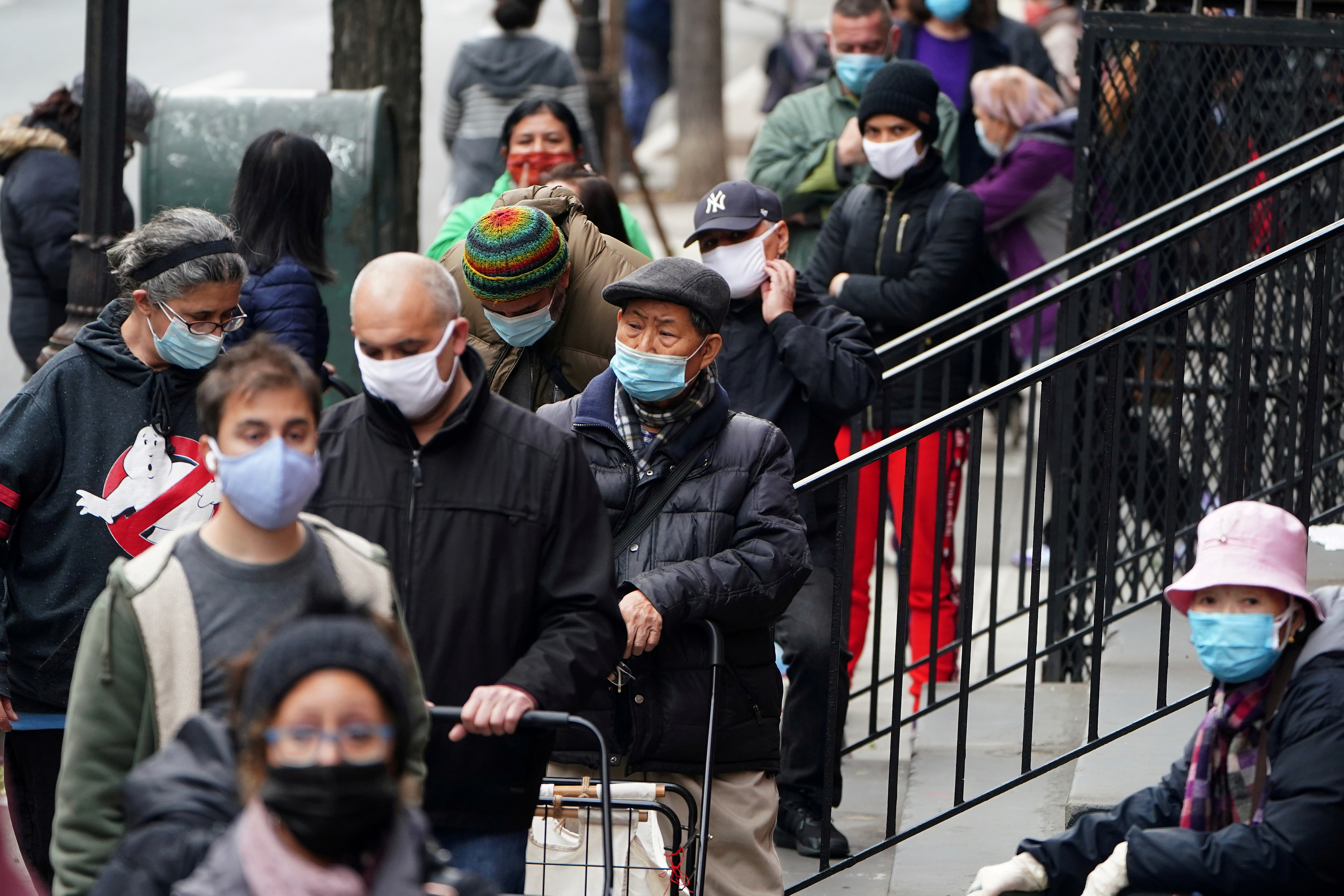 People wait in line at the St. Clements Food Pantry for food during the coronavirus disease (COVID-19) pandemic in the Manhattan borough of New York City, New York, U.S., December 11, 2020. REUTERS/Carlo Allegri