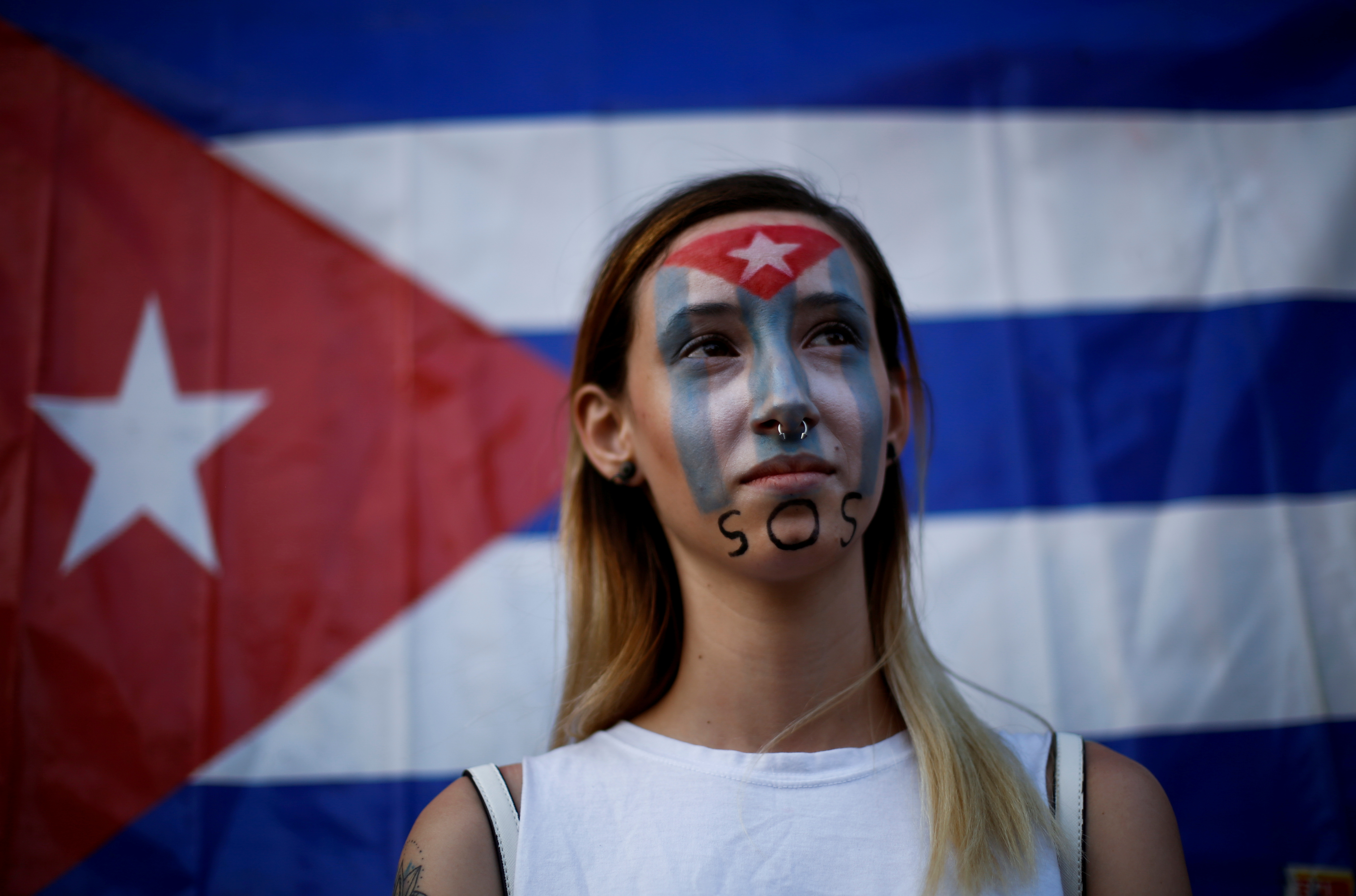 Anilet Ramirez from Cuba takes part in a protest against the Cuban government in front of the offices of the International Organization for Migration (IOM) in Ciudad Juarez, Mexico July 12, 2021. REUTERS/Jose Luis Gonzalez/File Photo