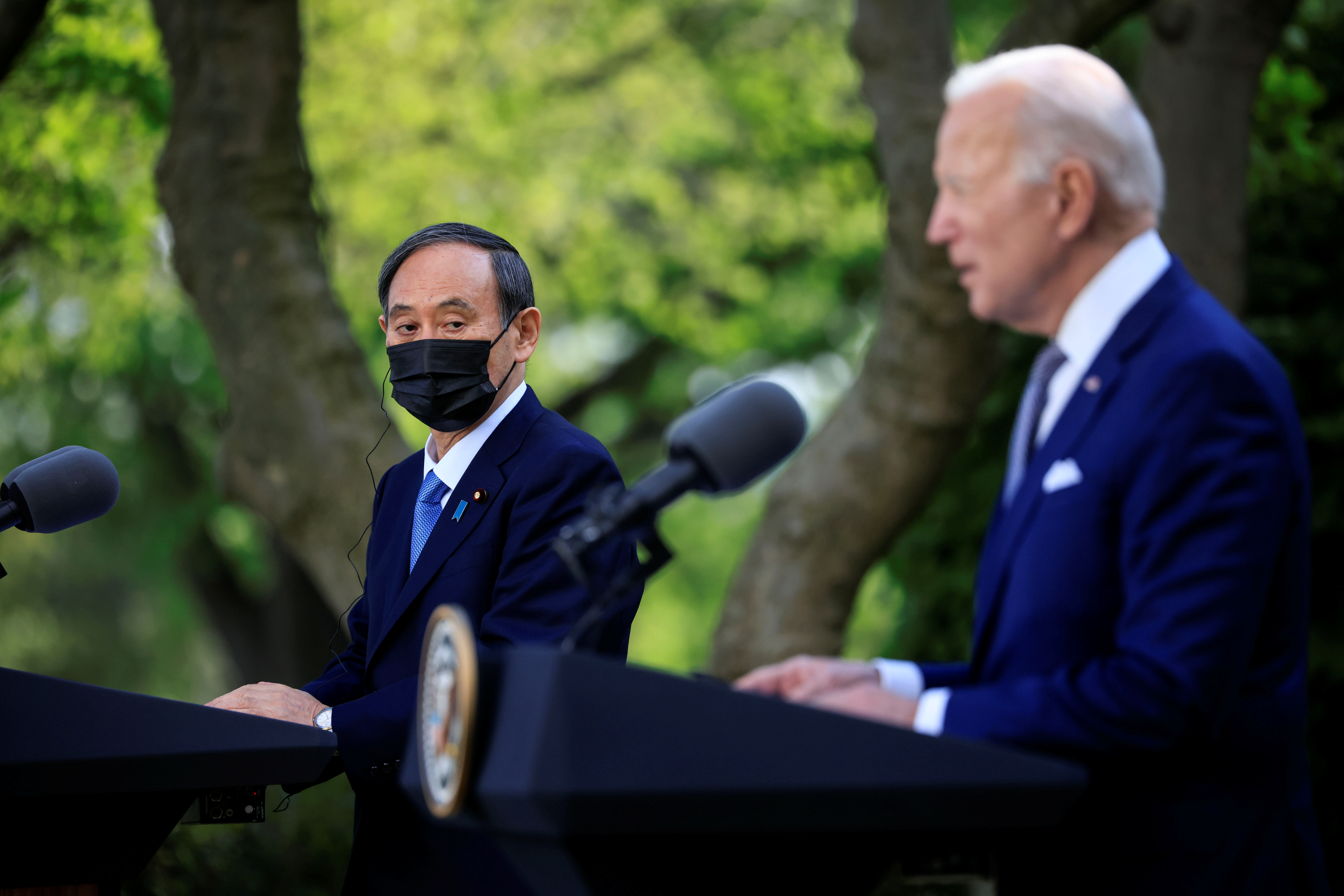 Japan's Prime Minister Yoshihide Suga and U.S. President Joe Biden hold a joint news conference in the Rose Garden at the White House in Washington, U.S., April 16, 2021. REUTERS/Tom Brenner