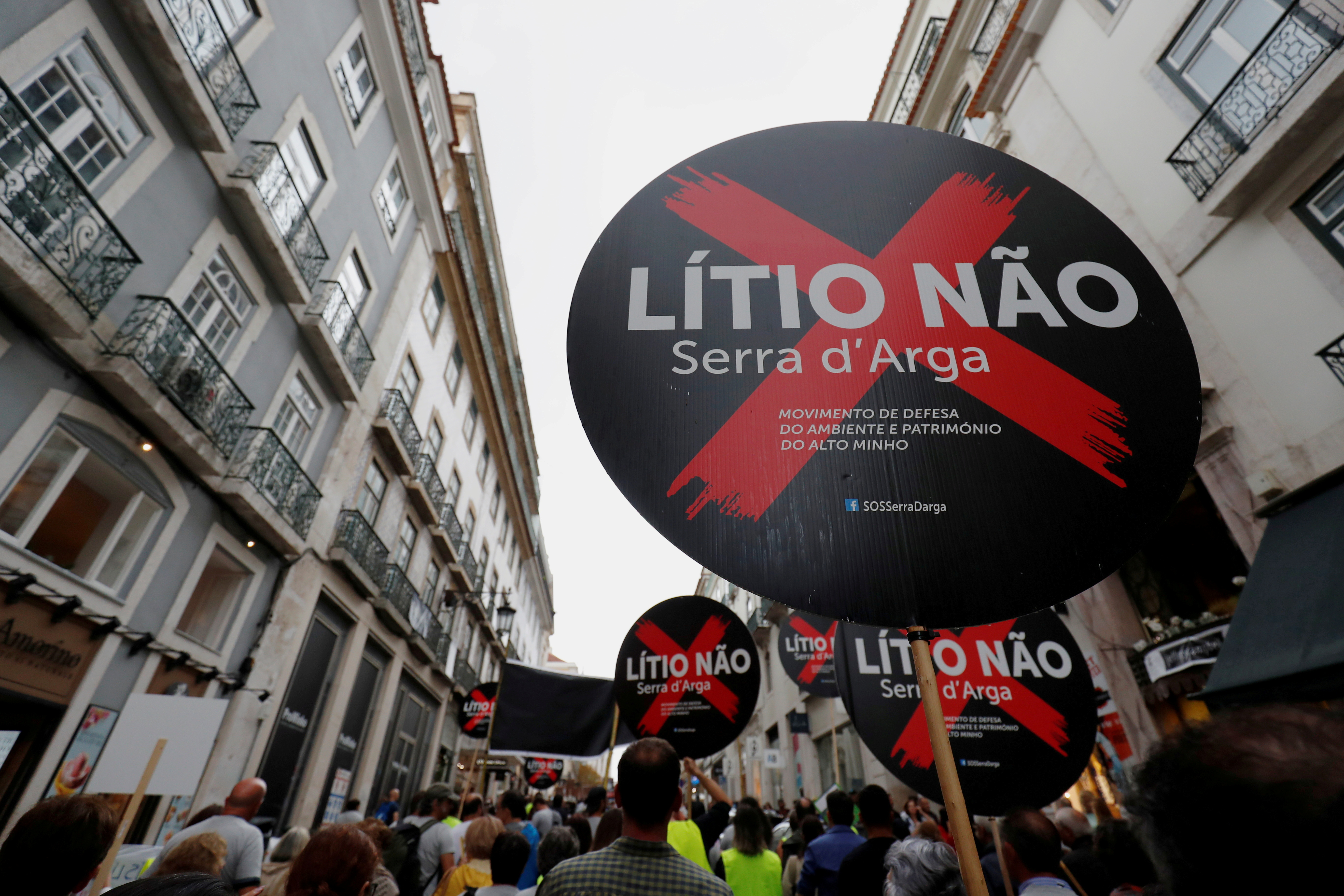 Demonstrators protest against lithium mines in downtown Lisbon, Portugal September 21, 2019. The placards read