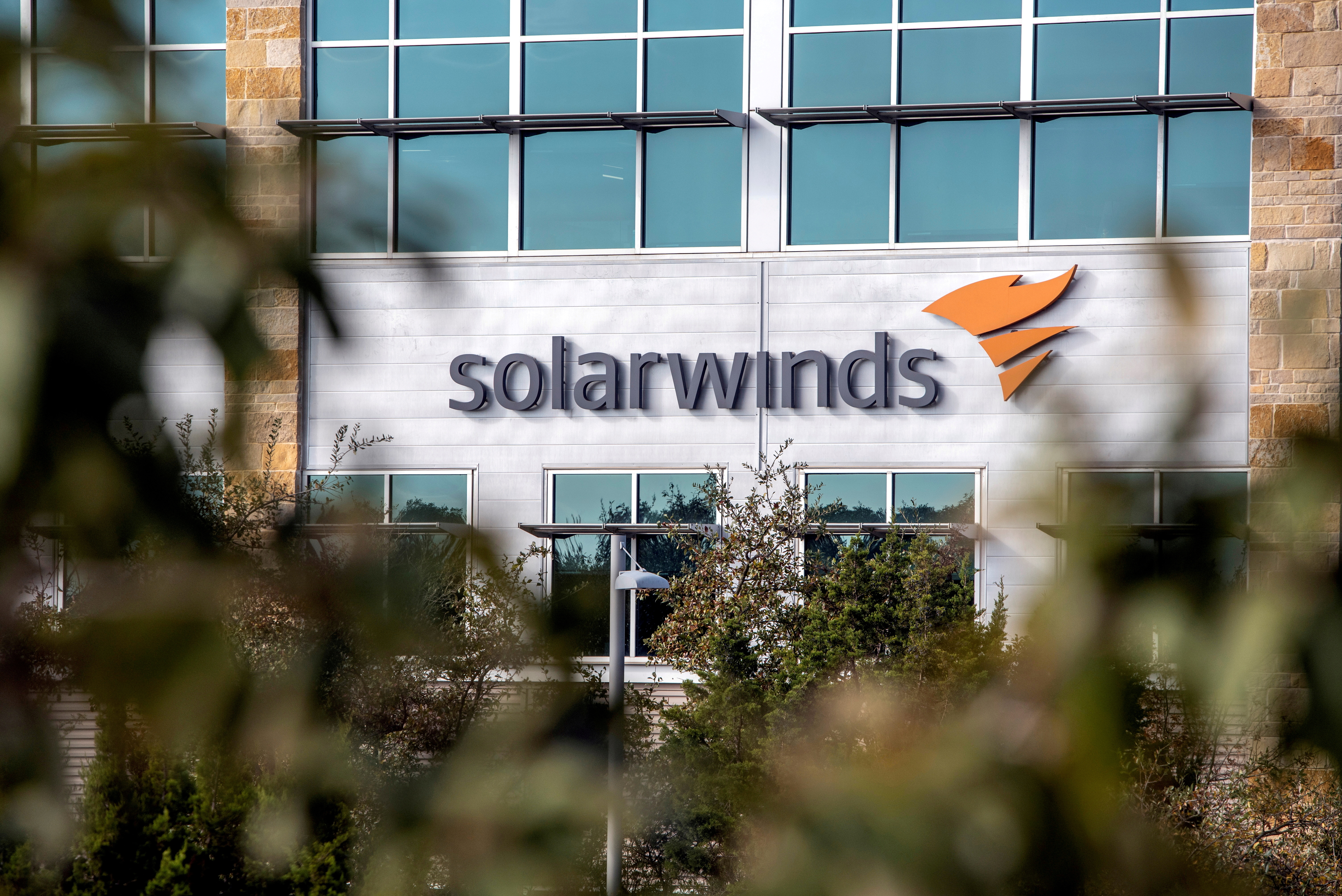 The SolarWinds logo is seen outside its headquarters in Austin, Texas, U.S., December 18, 2020. REUTERS/Sergio Flores/File Photo
