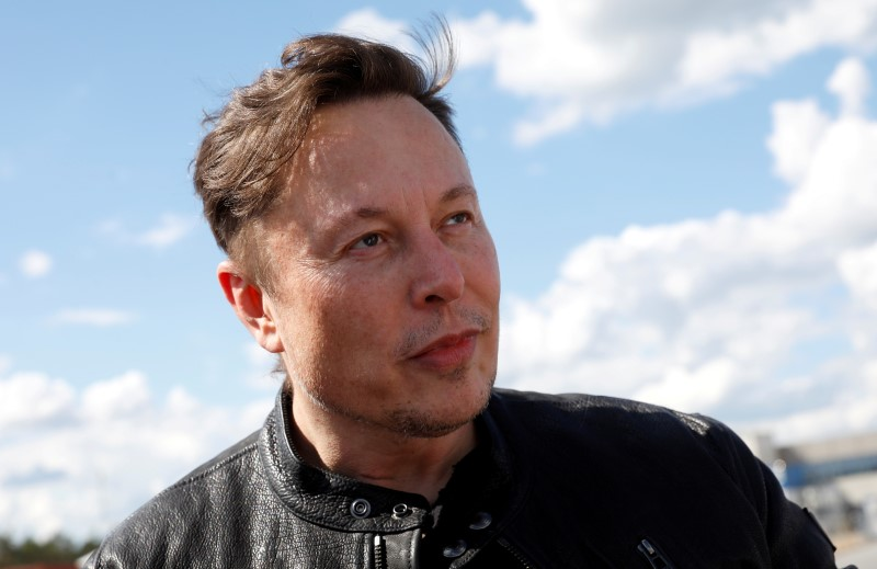 SpaceX founder and Tesla CEO Elon Musk looks on as he visits the construction site of Tesla's gigafactory in Gruenheide, near Berlin, Germany, May 17, 2021.