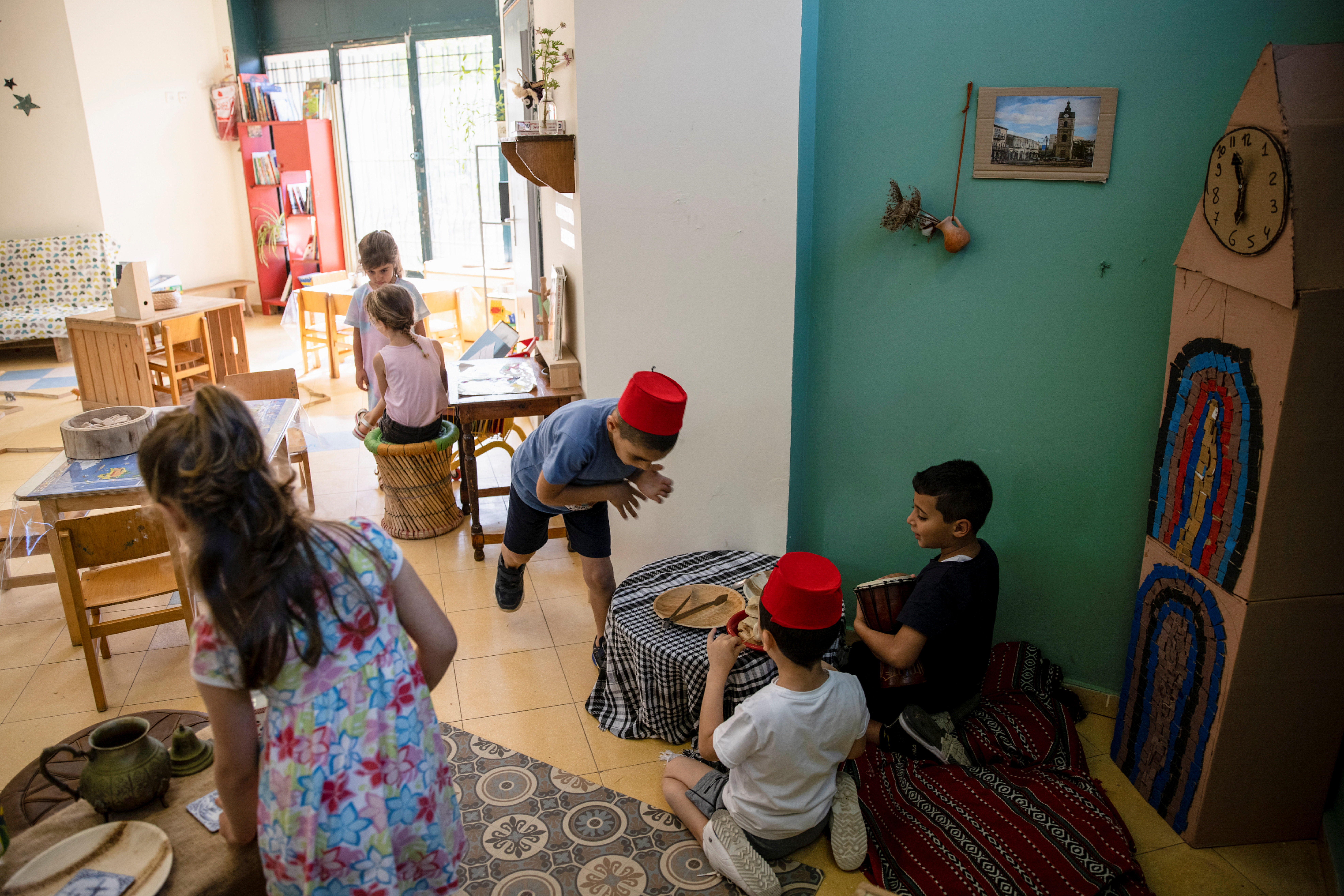 Children play in a classroom at Hand in Hand, a mixed Jewish-Arab kindergarten, in Jaffa, near Tel Aviv, Israel May 24, 2021. Picture taken May 24, 2021. REUTERS/Ronen Zvulun