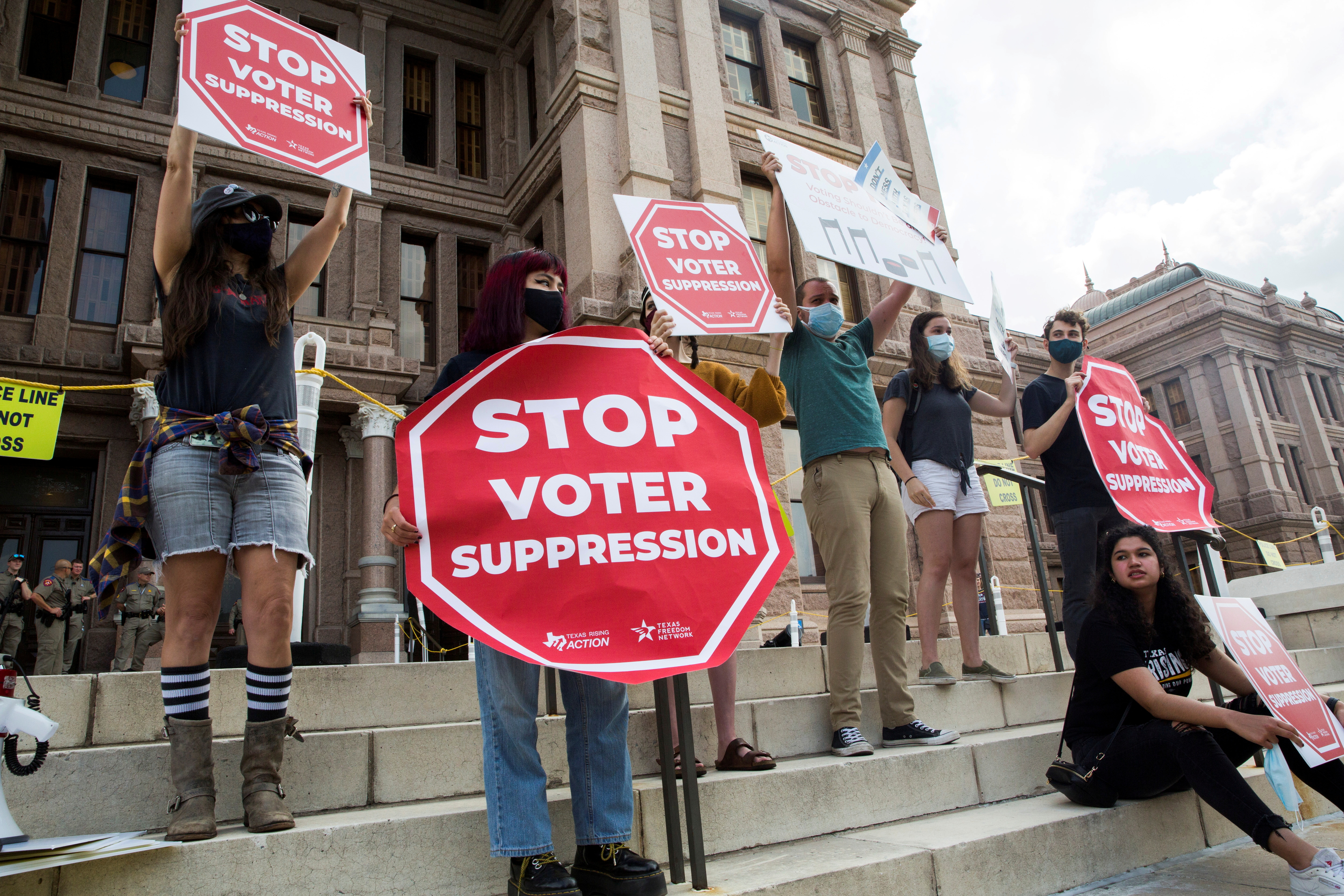 Voting rights activists gather during a protest against Texas legislators who are advancing a slew of new voting restrictions in Austin, Texas, U.S., May 8, 2021.  REUTERS/Mikala Compton/File Photo