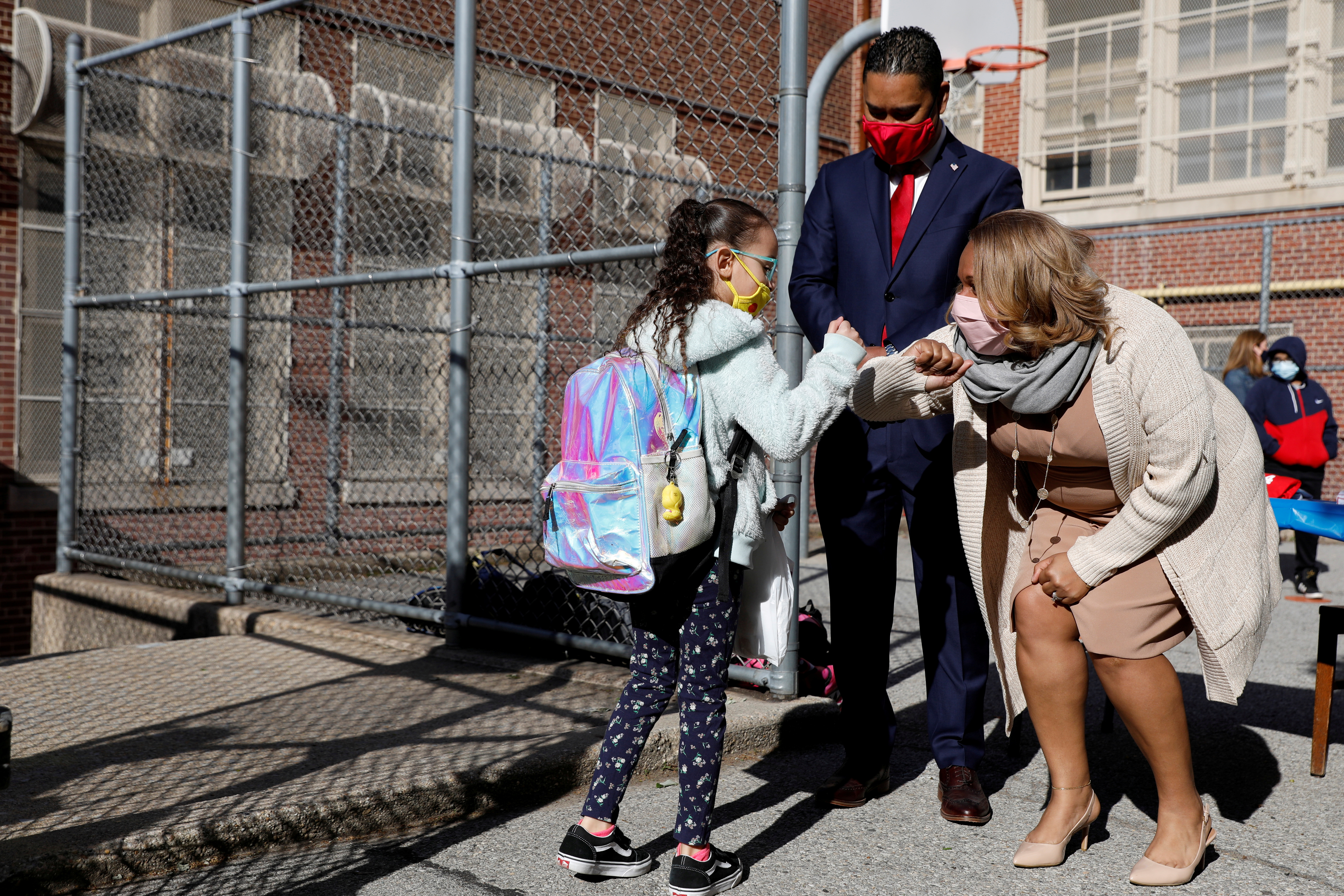 Meisha Porter, Chancellor of the New York City Department of Education, greets a P.S. 064 Robert Simon student as children return to school during the outbreak of COVID-19 in Manhattan, New York City, New York, U.S., April 26, 2021. REUTERS/Andrew Kelly/File Photo