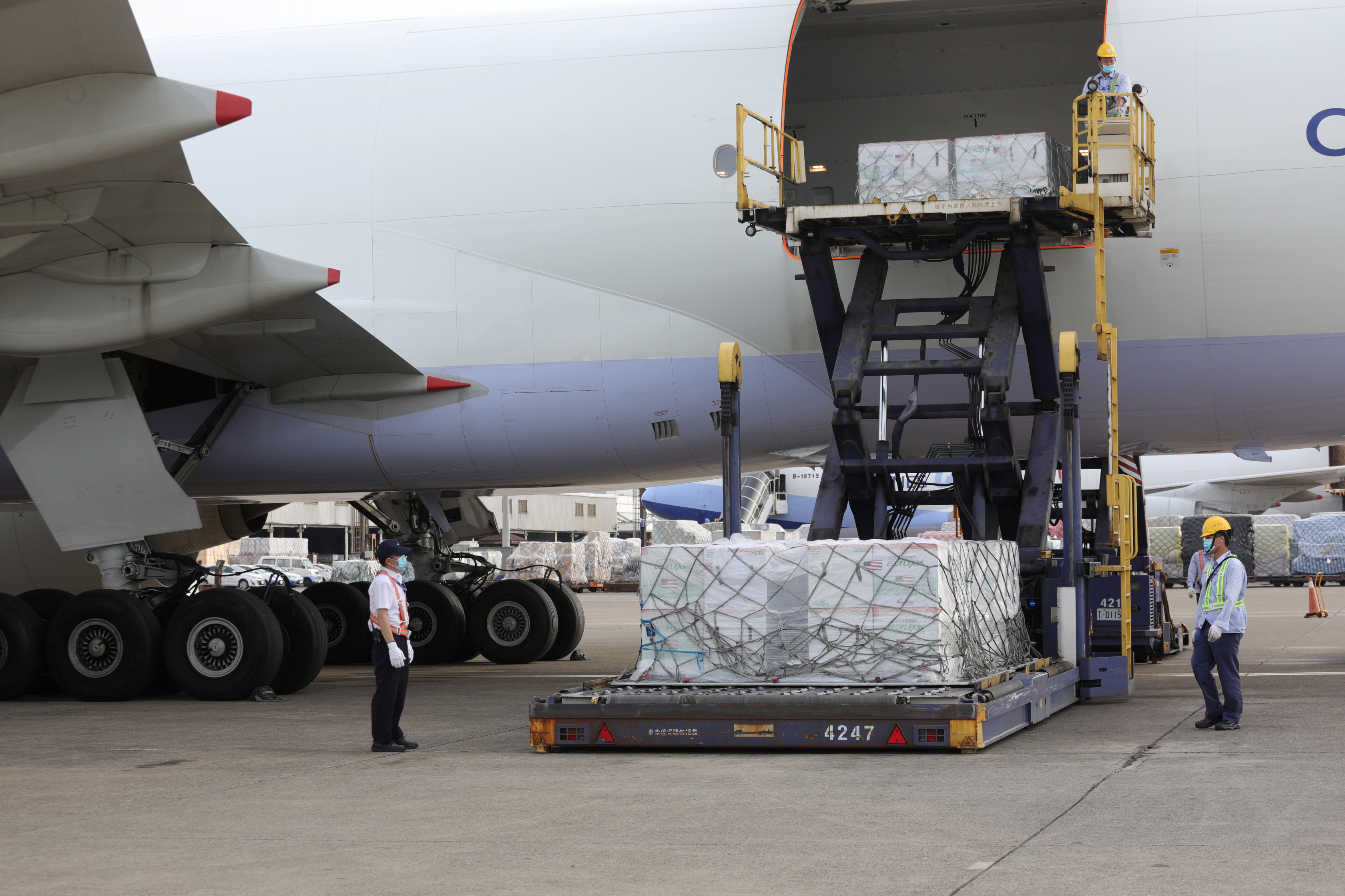Workers unload Moderna vaccines against the coronavirus disease (COVID-19) shipped from the United States, at Taoyuan International airport in Taoyuan, Taiwan, June 20, 2021. Taiwan Centers for Disease Control/Handout via REUTERS