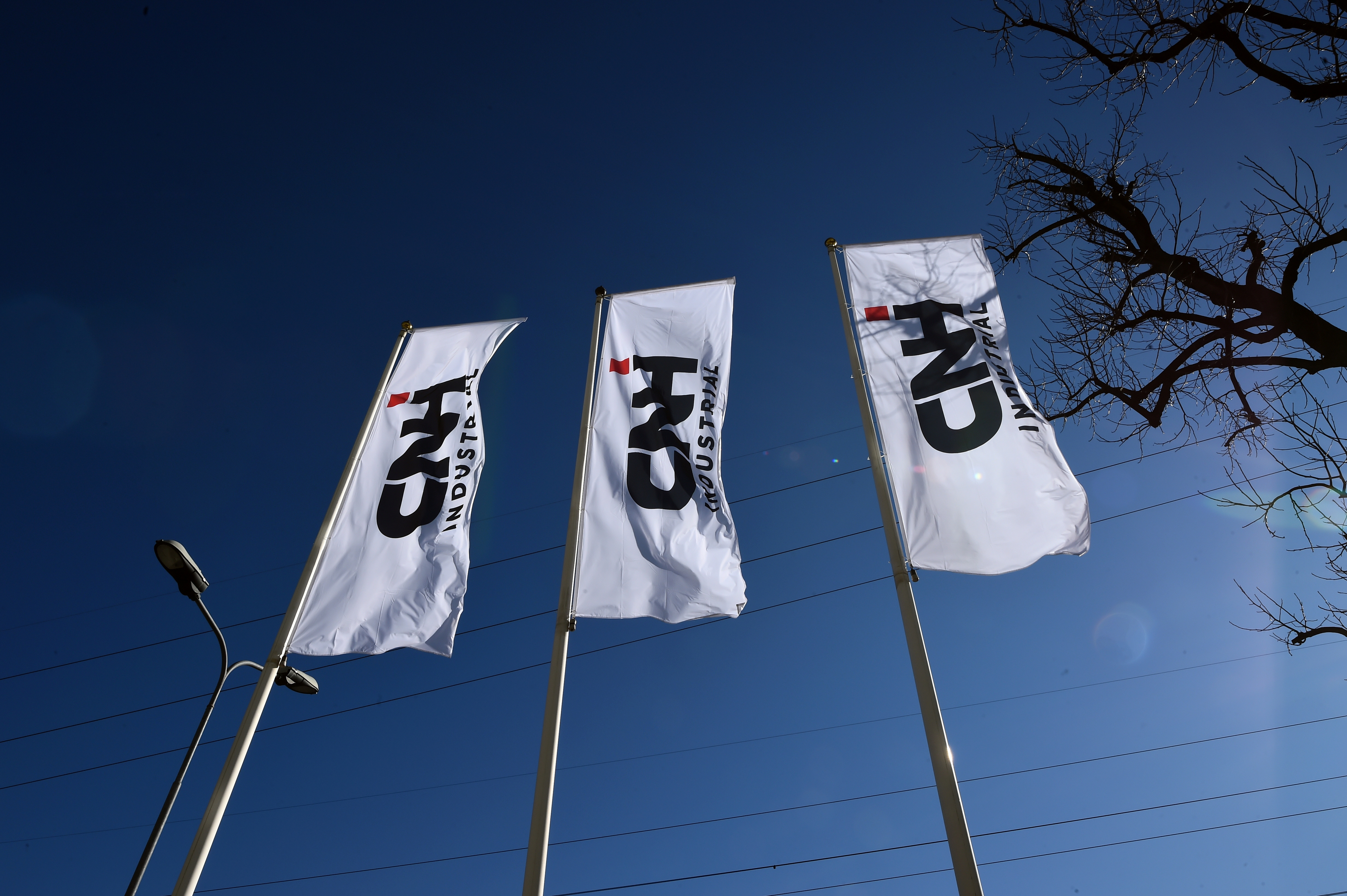 Flags with CNH Industrial logo are pictured outside CNH Industrial building in Turin, Italy, February 5, 2020. REUTERS/ Massimo Pinca/File Photo