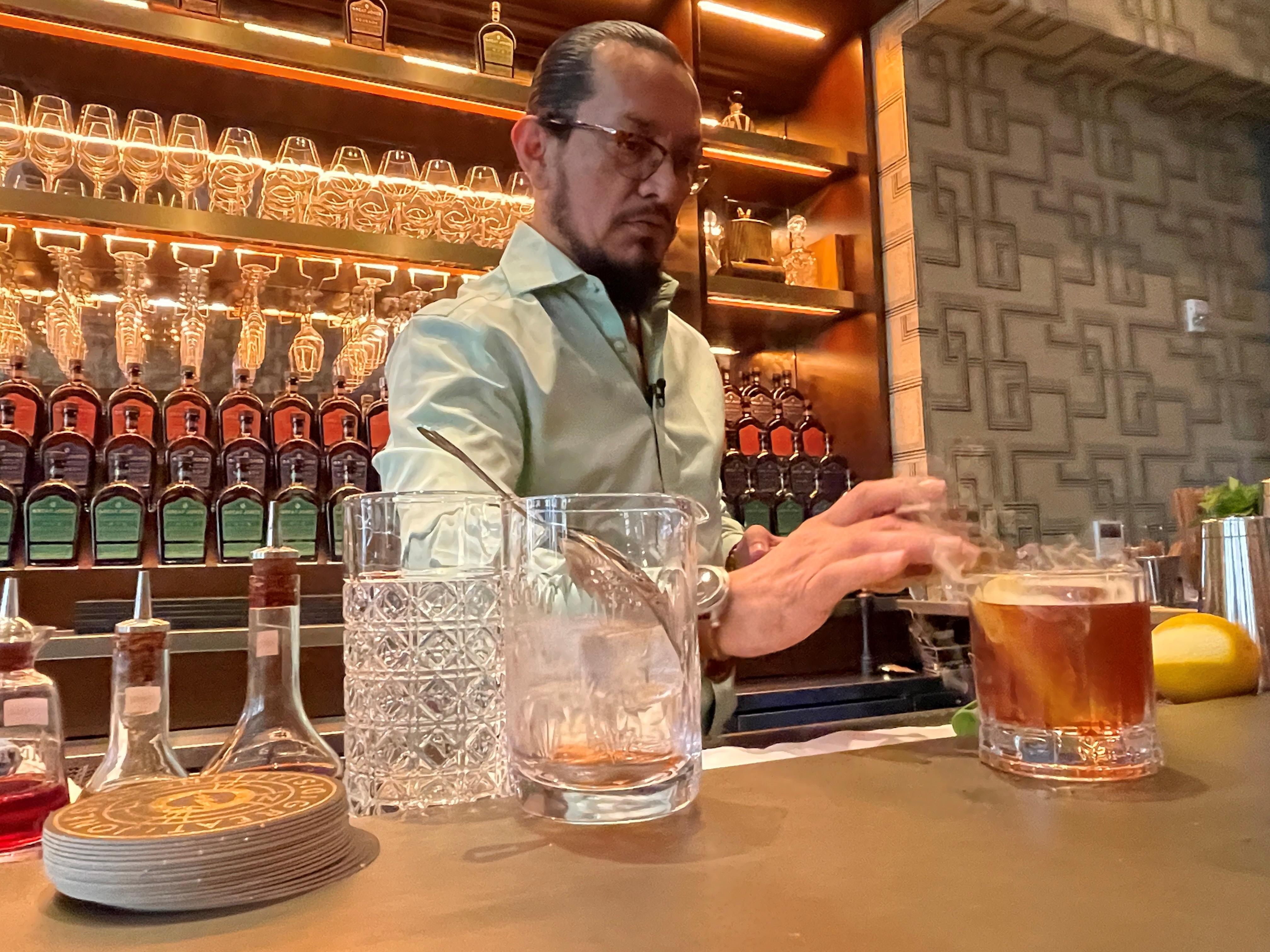 Esteban Ordonez, Great Jones Distilling Co. brand ambassador, makes a smoked Old Fashioned drink in New York, NY, U.S., September 16, 2021. Picture taken September 16, 2021. REUTERS/Roselle Chen
