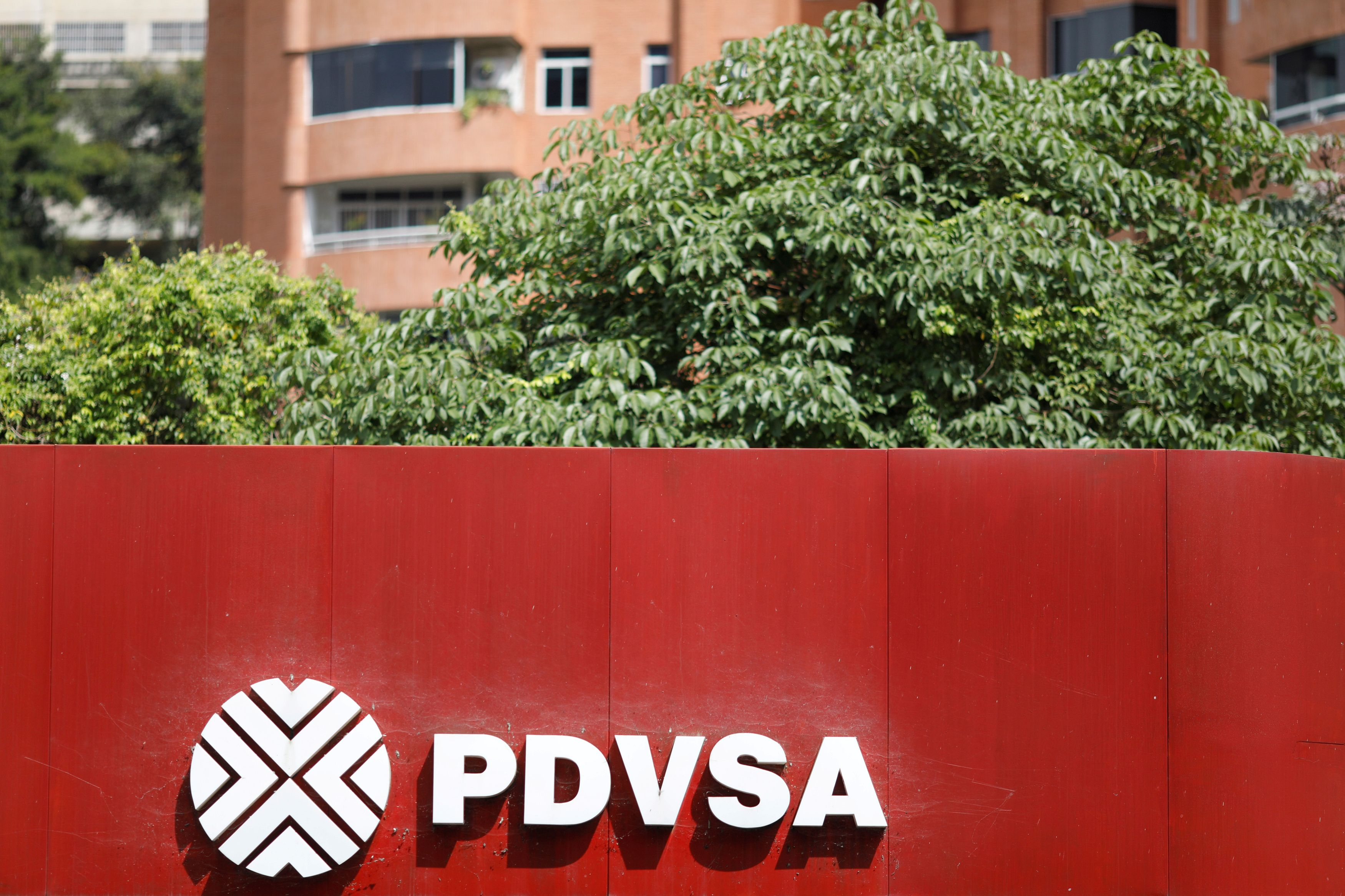 The corporate logo of the state oil company PDVSA is seen at a gas station in Caracas, Venezuela November 16, 2017. REUTERS/Marco Bello/File Photo