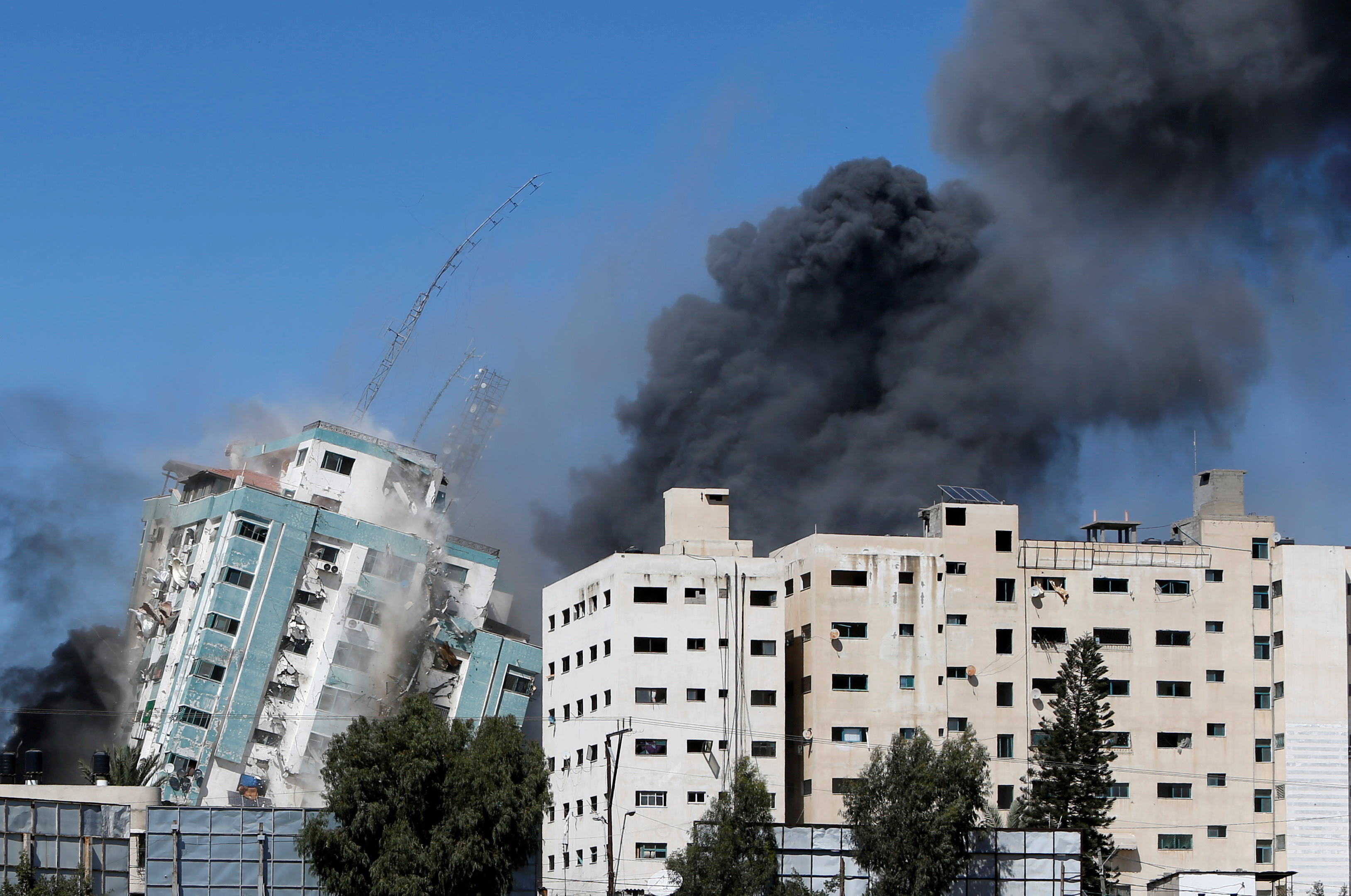 A tower housing AP, Al Jazeera offices collapses after Israeli missile strikes in Gaza city, May 15. REUTERS/Mohammed Salem