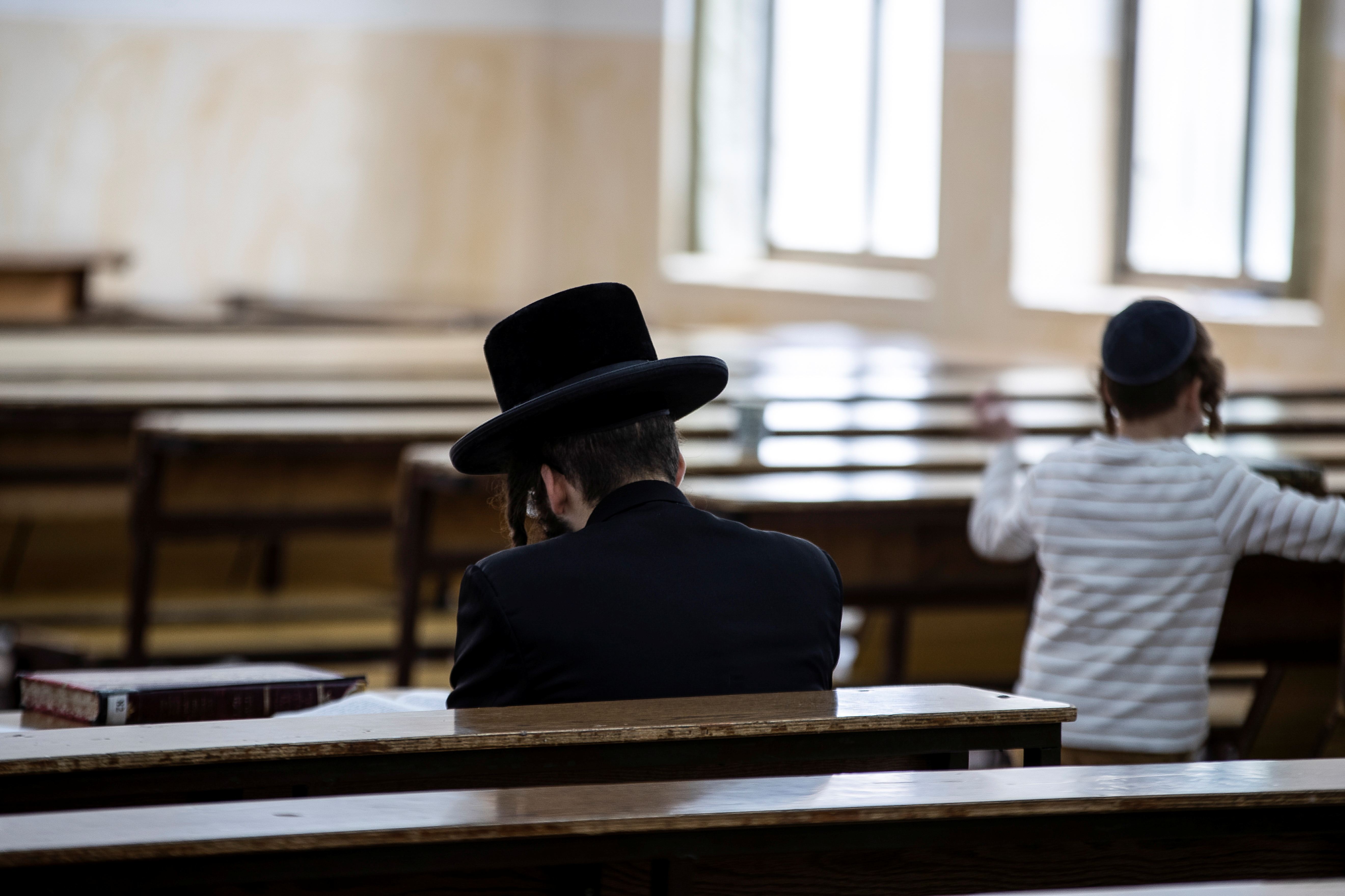 An Ultra Orthodox Jewish man sits in a religious study room in Jerusalem July 25, 2021.   REUTERS/ Ronen Zvulun