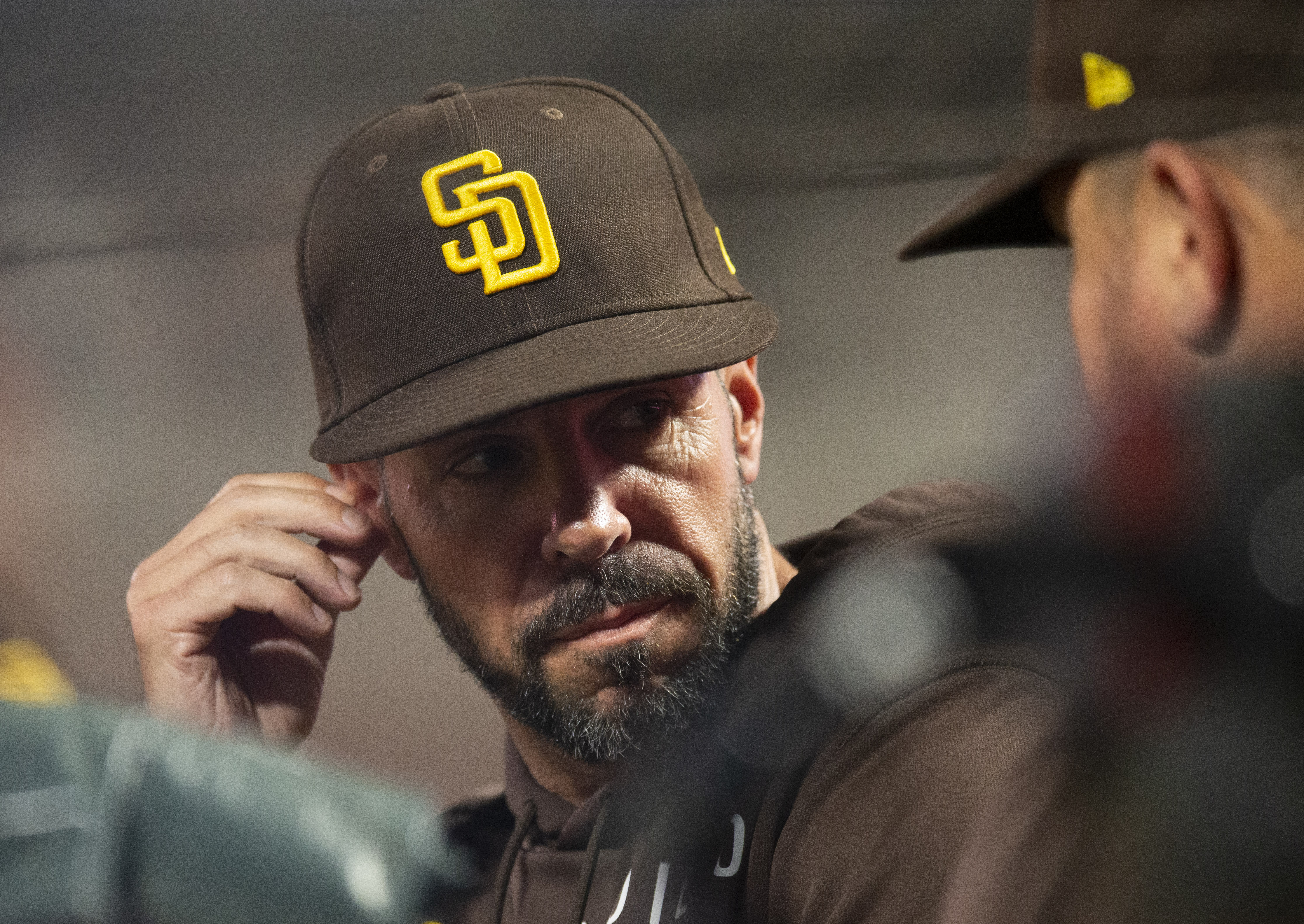 Oct 1, 2021; San Francisco, California, USA; San Diego Padres supervisor Jayce Tingler (32) consults with a coach in the course of the third inning towards the San Francisco Giants at Oracle Park. Mandatory Credit: D. Ross Cameron-USA TODAY Sports