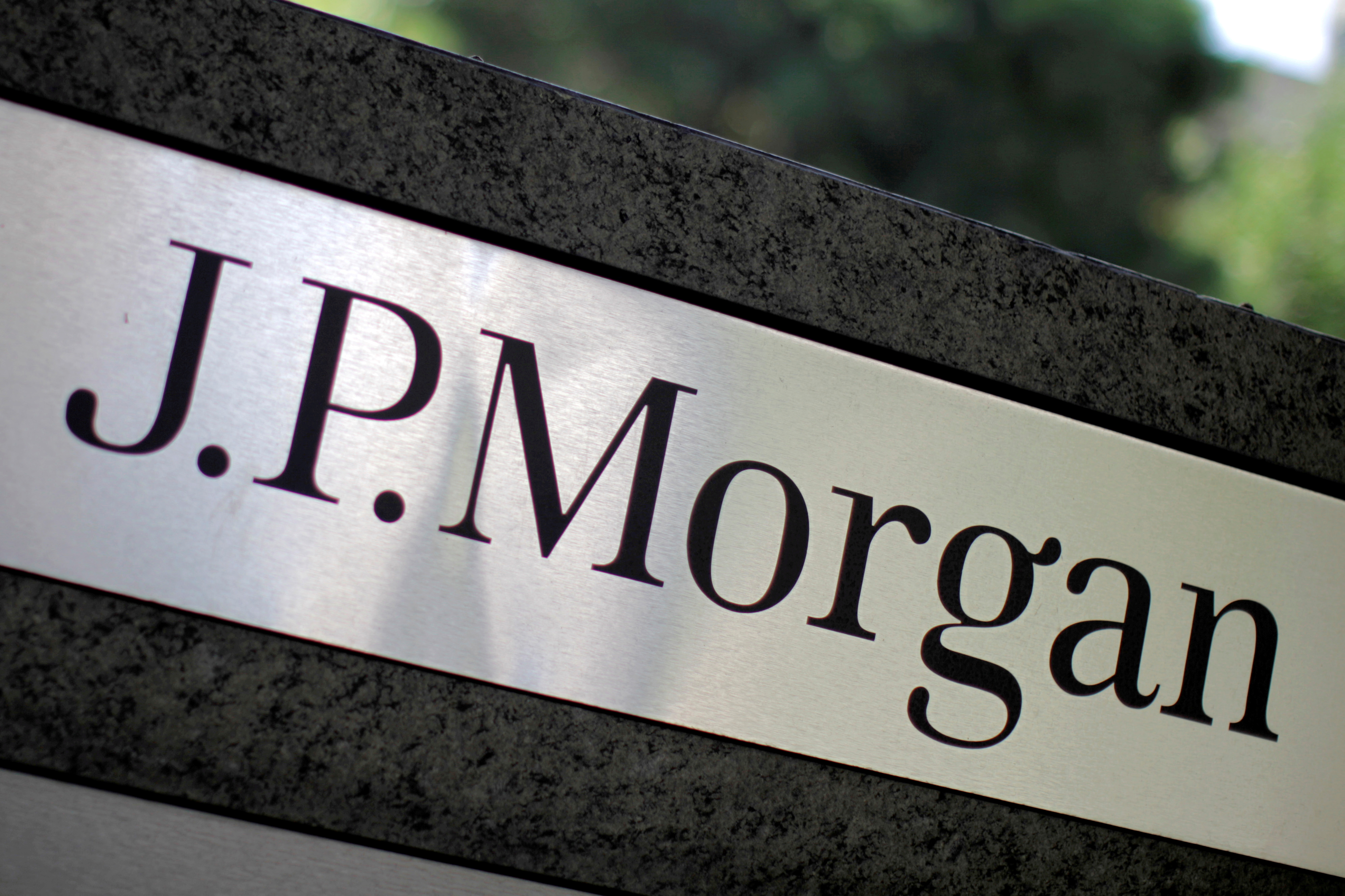 FILE PHOTO: The logo of Dow Jones Industrial Average stock market index listed company JPMorgan Chase (JPM) is seen in Los Angeles, California, United States, in this October 12, 2010 file photo. JPMorgan Chase & Co. owns Chase Commerical Bank and JPMorgan Investment Bank.  REUTERS/Lucy Nicholson