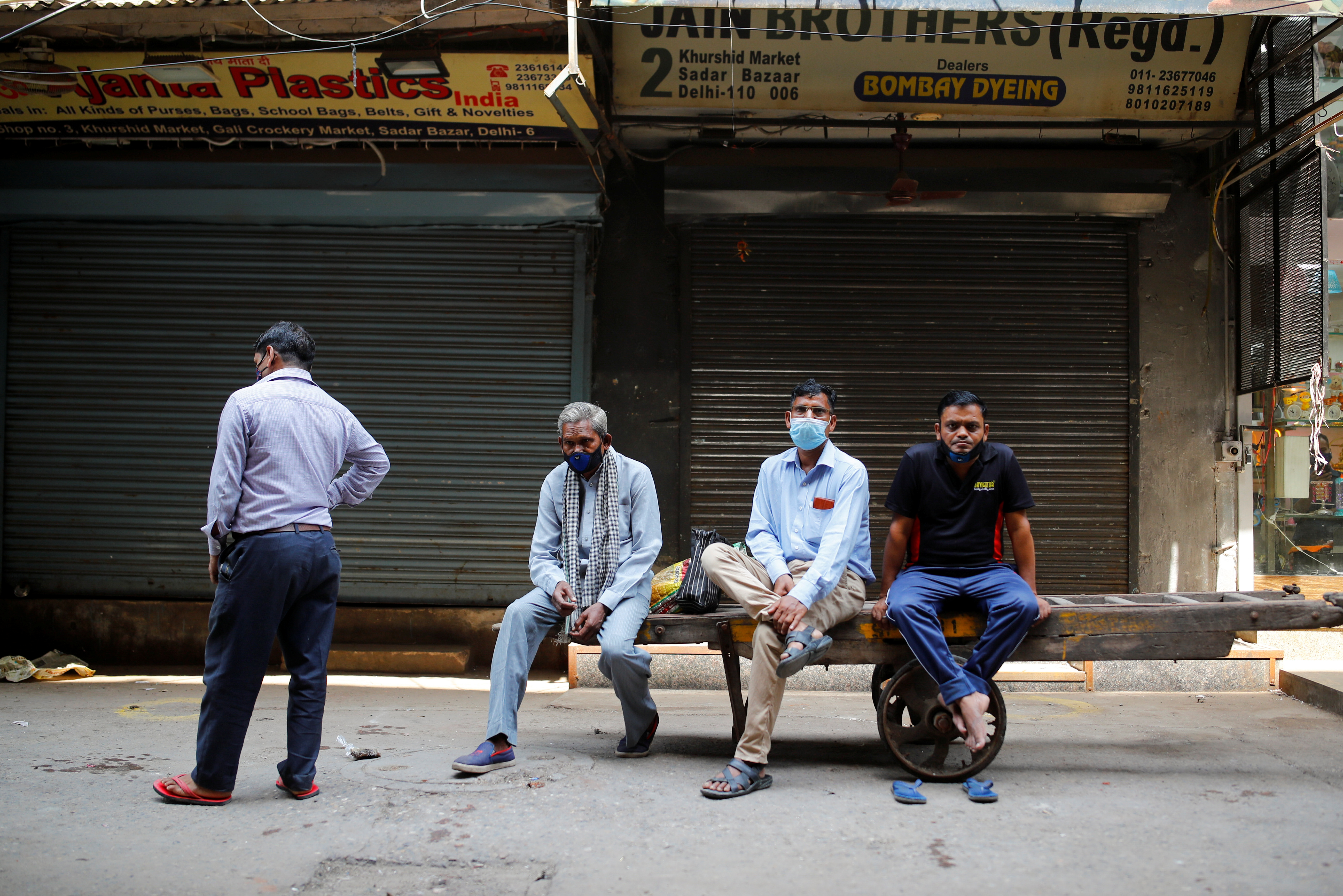 Shopkeepers wait to open their stores at a market area after authorities eased lockdown restrictions that were imposed to slow down the spread of the coronavirus disease (COVID-19), in New Delhi, India, June 7, 2021. REUTERS/Adnan Abidi