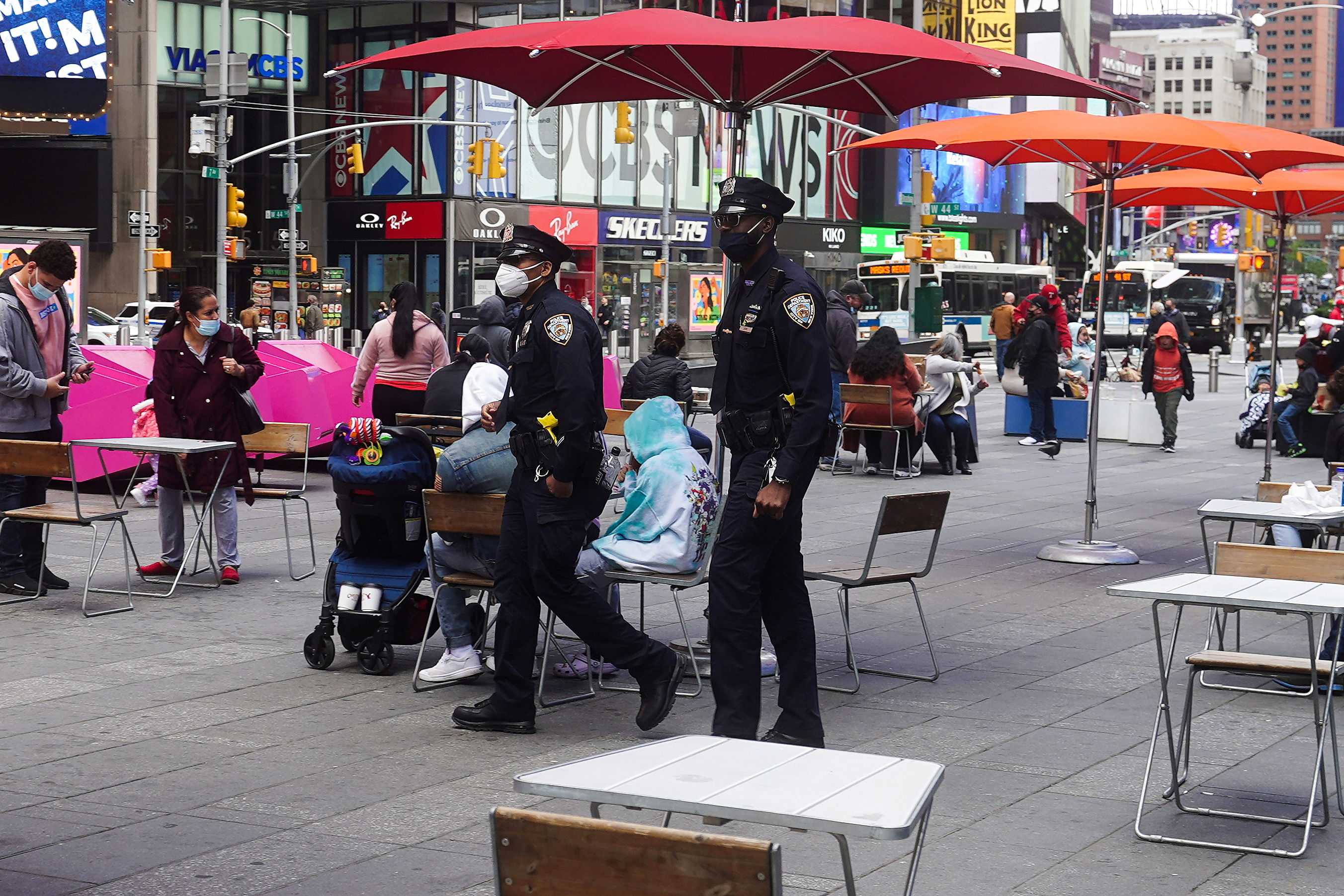 Police officers walk through Times Square in the Manhattan borough of New York City, New York, U.S., May 10, 2021.  REUTERS/Carlo Allegri/File Photo