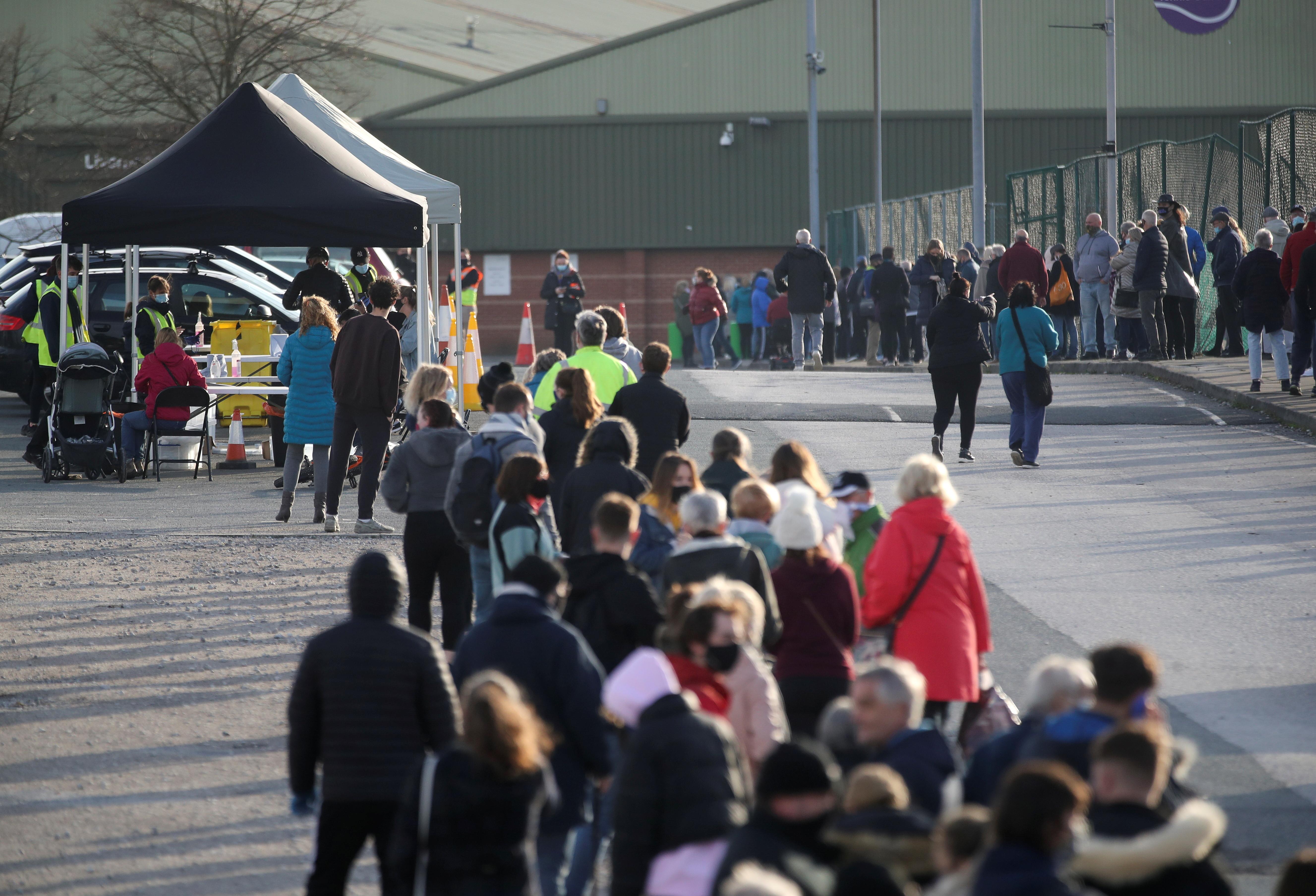 People queue at the coronavirus disease (COVID-19) testing centre in Liverpool, Britain November 6, 2020. REUTERS/Carl Recine