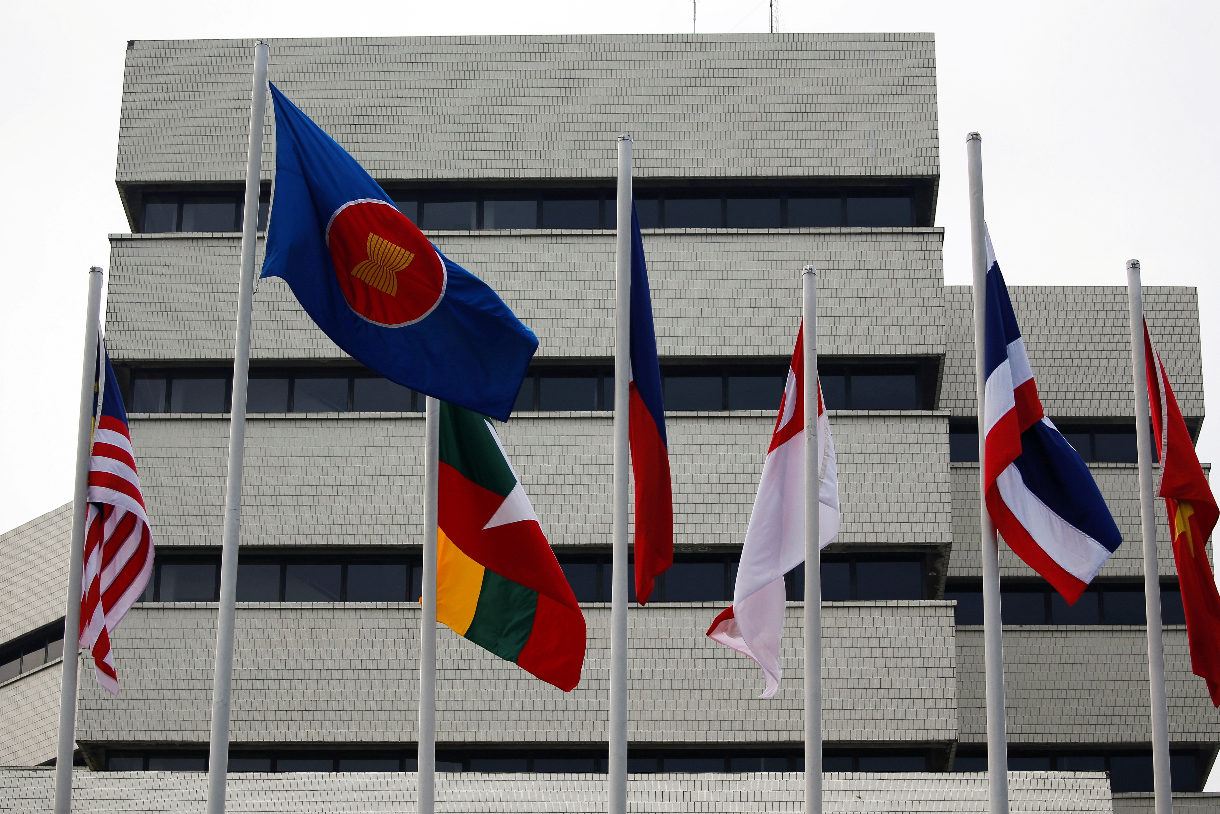 Flags are seen outside the Association of Southeast Asian Nations (ASEAN) secretariat building, ahead of the ASEAN leaders' meeting in Jakarta, Indonesia, April 23, 2021. REUTERS/Willy Kurniawan/File Photo