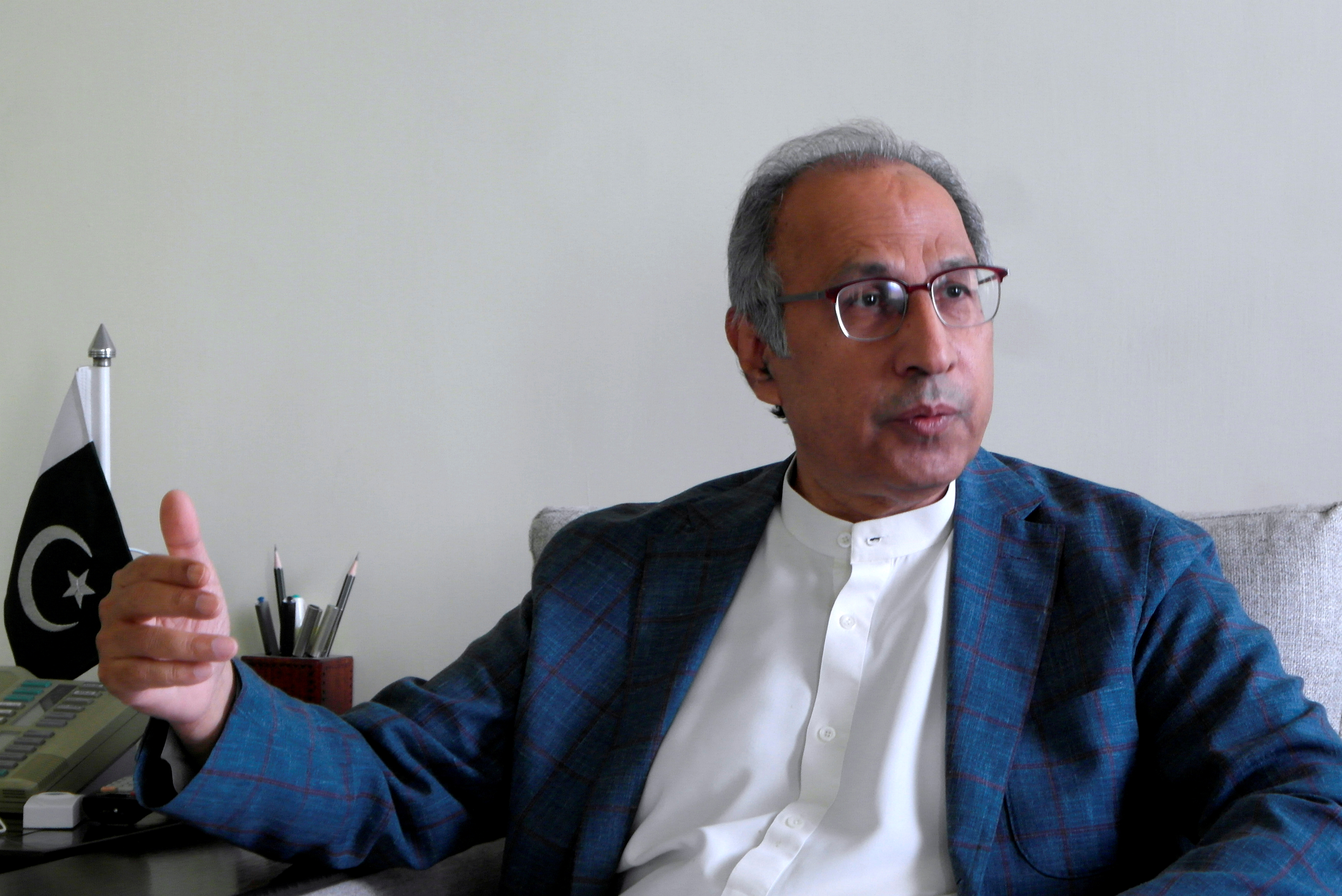 Pakistan's Finance Minister Abdul Hafeez Shaikh speaks during an interview with Reuters at his office, as the coronavirus disease (COVID-19) outbreak continues, in Islamabad, Pakistan May 8, 2020. REUTERS/Asif Shahzad